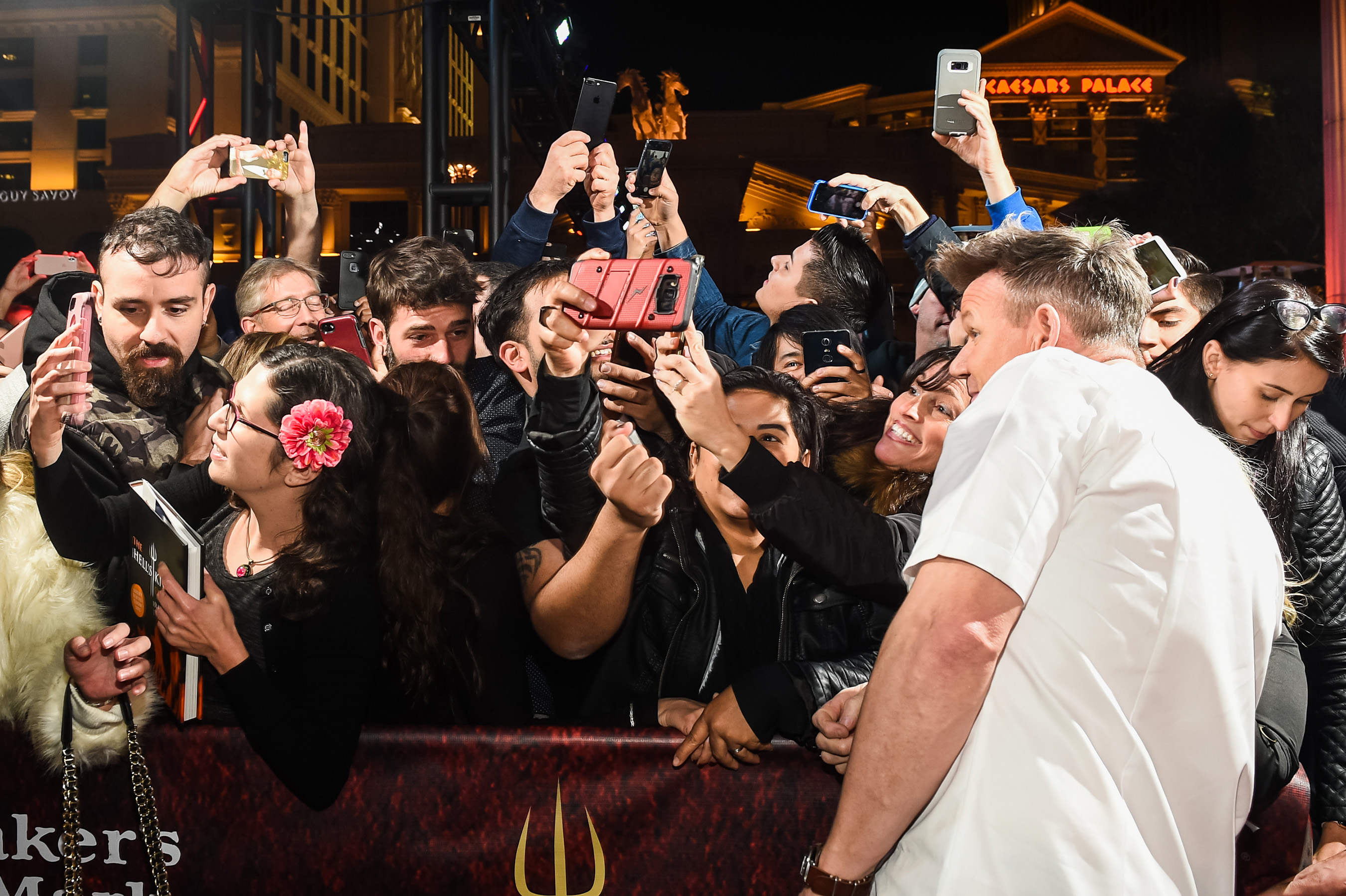 Chef Gordon Ramsay poses for selfies with fans during the grand opening celebration of the world's first Gordon Ramsay HELL'S KITCHEN restaurant at Caesars Palace in Las Vegas. Photo Credit: © Brenton Ho/ KabikPhotoGroup.com
