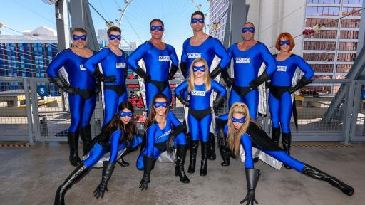 Photo of the zipline superheroes dressed in blue tight suits.