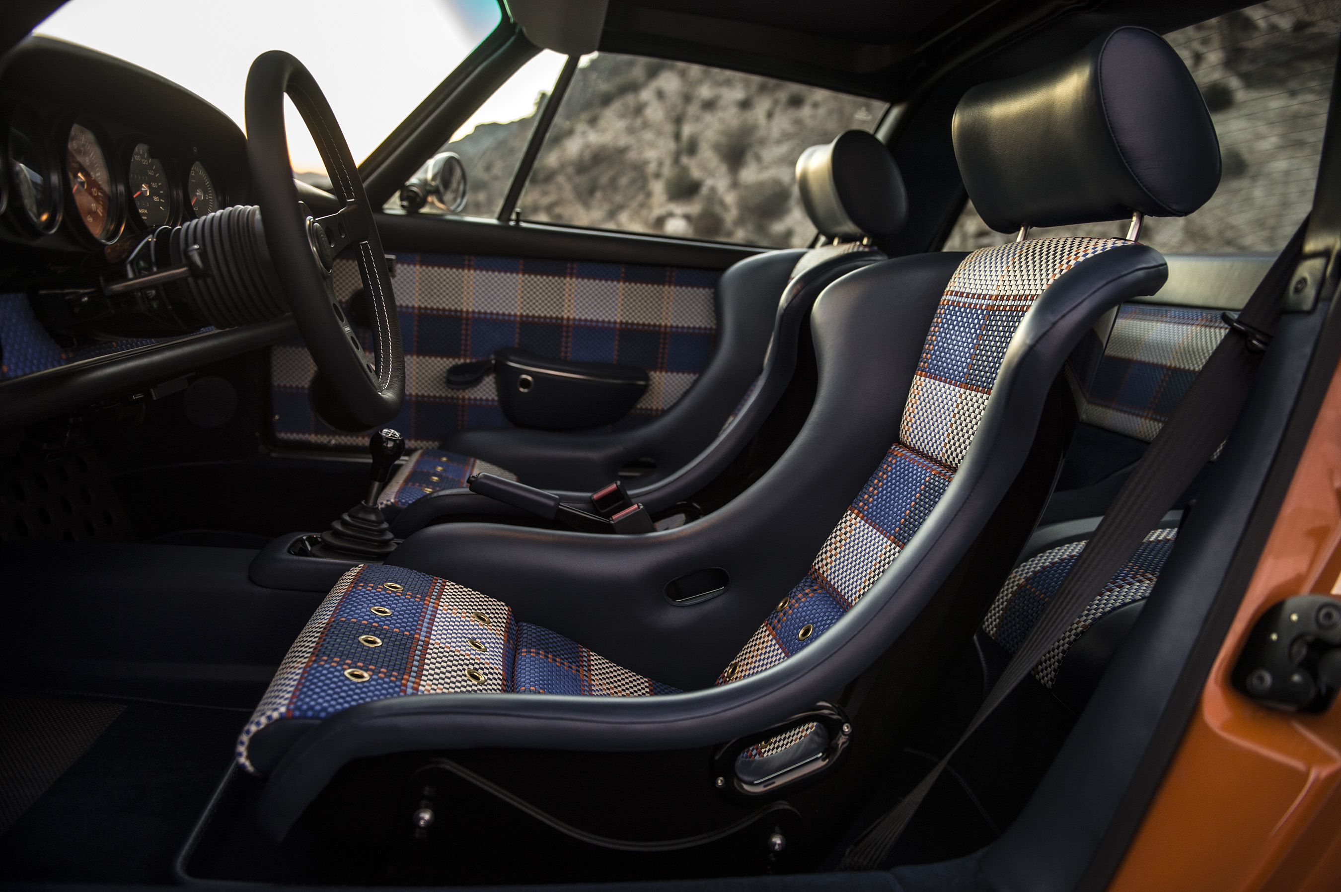 Incredibly bespoke 7-color 'Tyler Tartan' leather weave interior for 'Luxemburg' – with 2 oranges, 4 shades of blue and 1 cream – showcasing special wishes brought to life by Singer Vehicle Design.