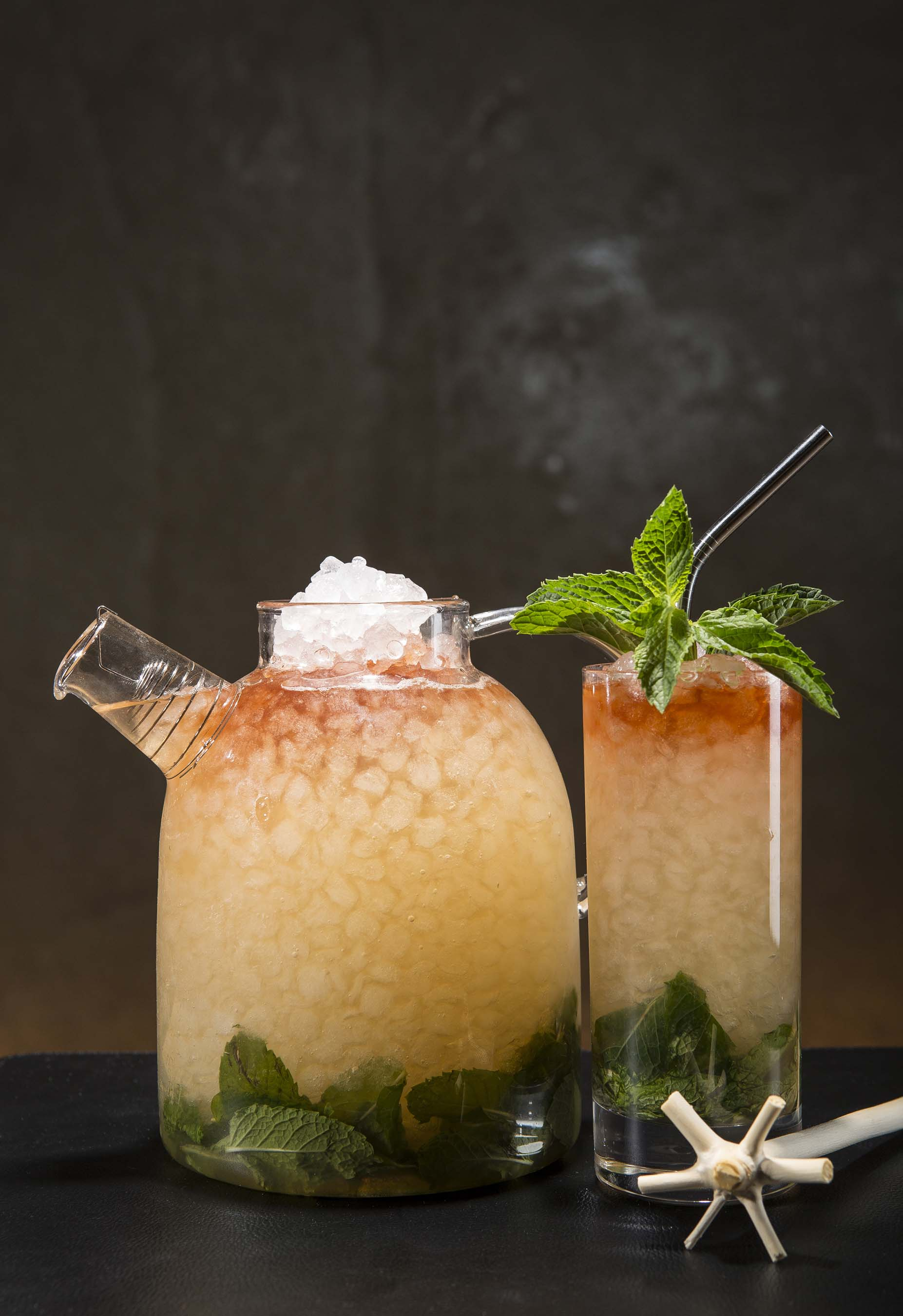Inspired by the Queens Park Hotel in Trinidad, El Dorado rum, demerara syrup, lime juice, spearmint and Angostura bitters are mixed together with a swizzle stick and served on ice.