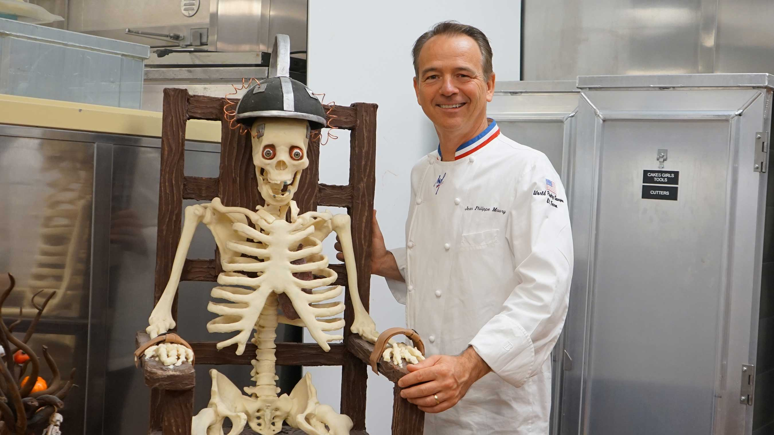 Jean Philippe Maury pictured with life-size skeleton showpiece made from 130 pounds of white and dark chocolate