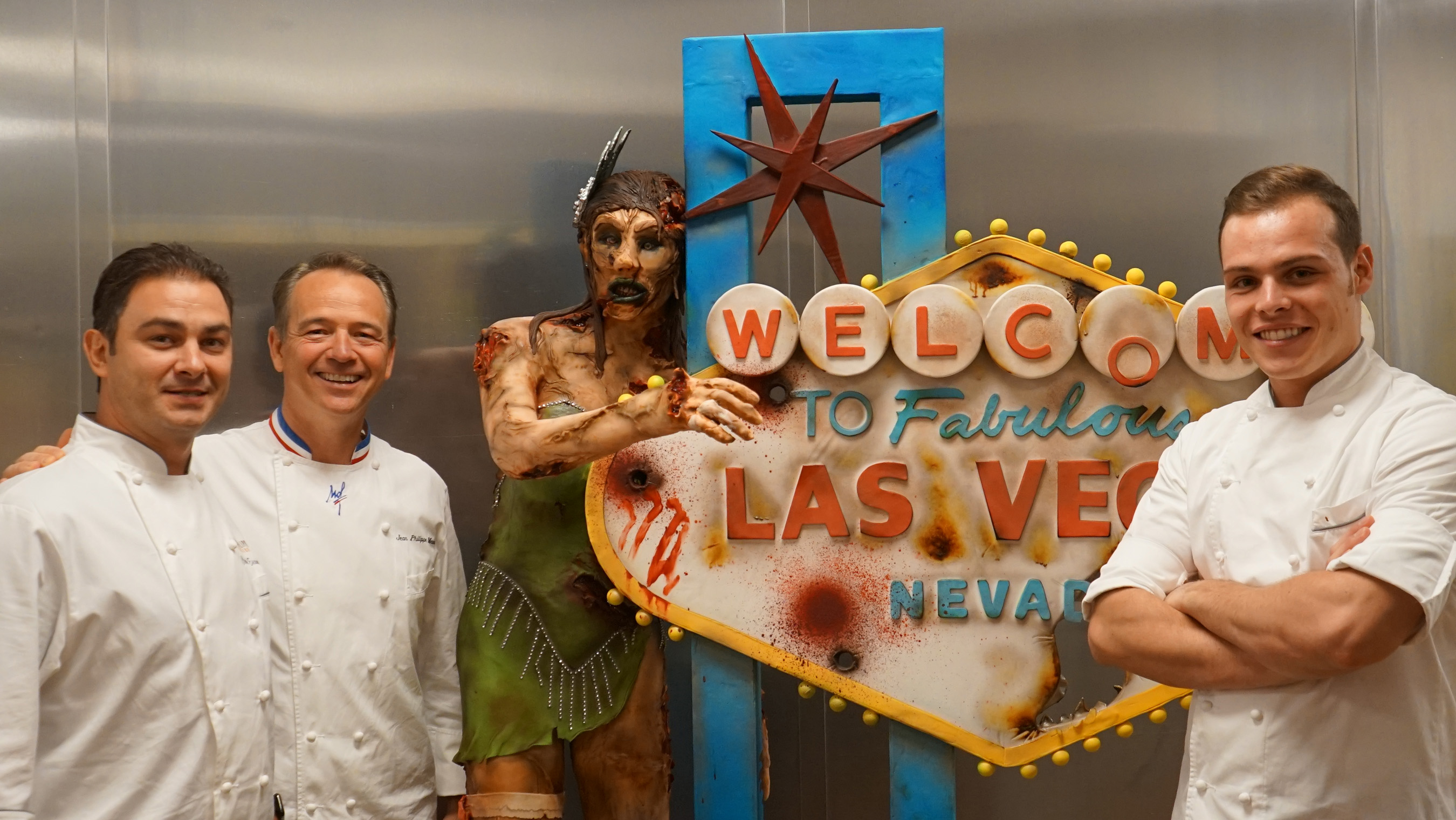 Chef Jean Philippe Maury, Executive Pastry Chef Claude Escamilla and Assistant Executive Pastry Chef Amaury Guichon pictured with Bellagio's main Halloween showpiece, the zombie showgirl