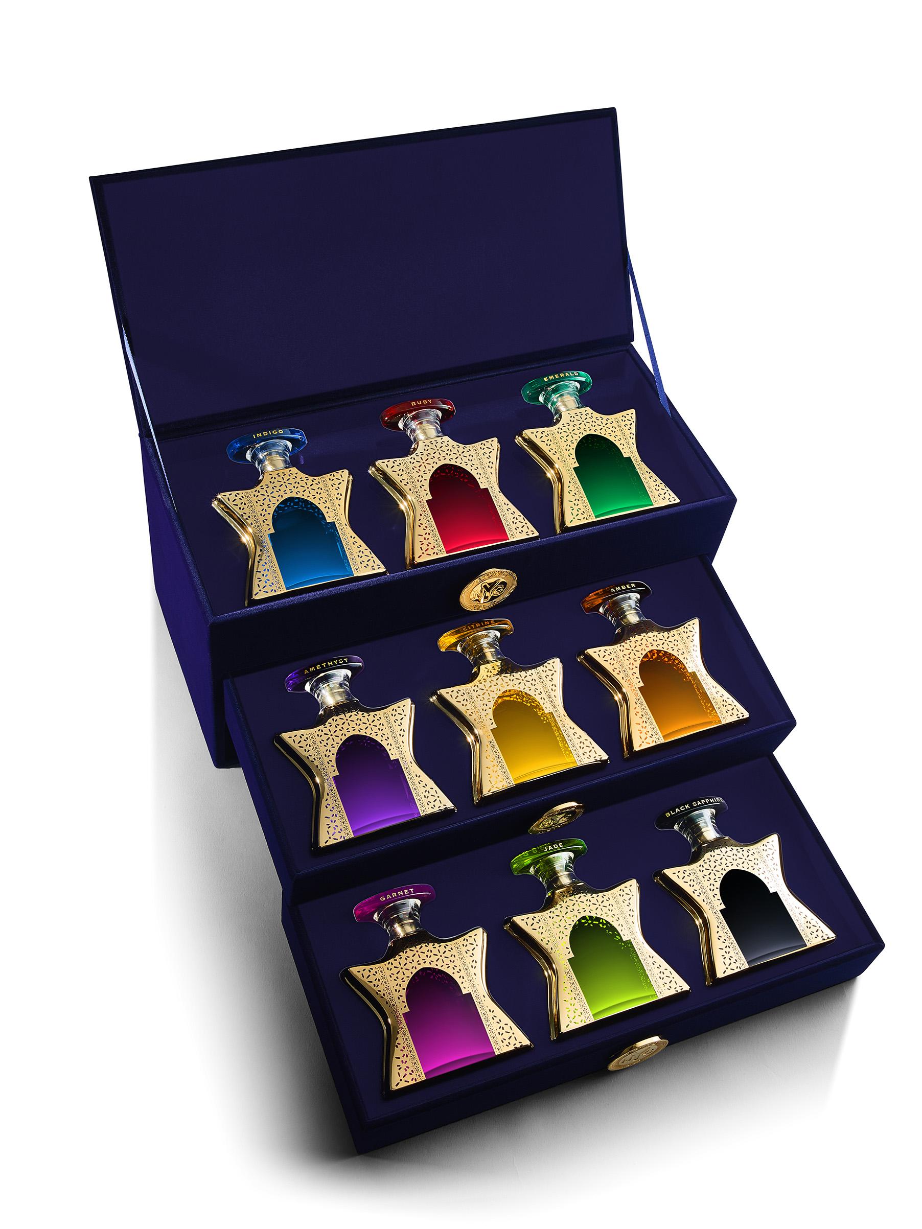 A sumptuous three-tier midnight blue velvet jewel box, fitted with each of the original nine Dubai eaux de parfum.