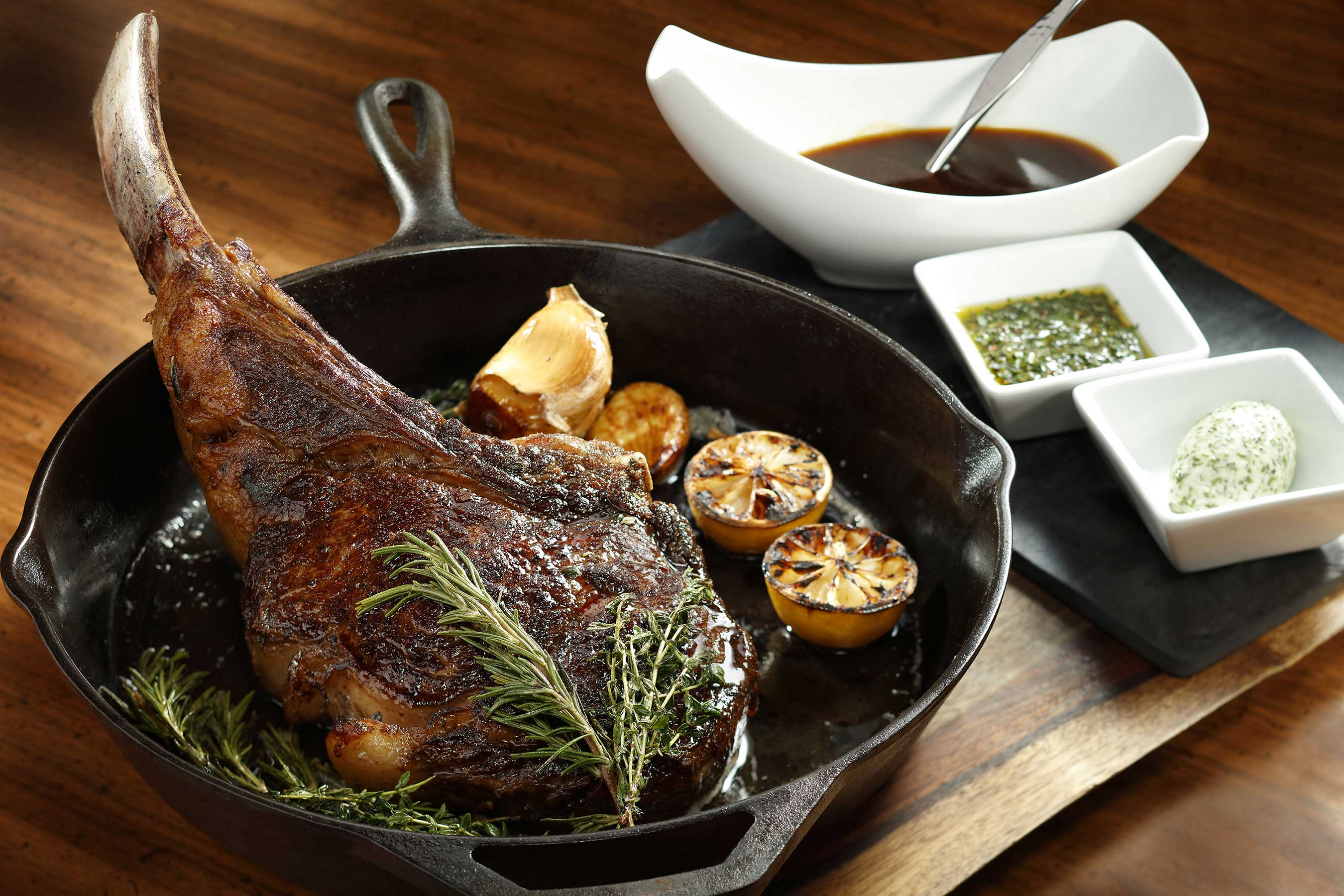 A 54-ounce Mishima Prime Tomahawk Ribeye steak is cooked to perfection and served alongside Chef Morimoto's signature sweet onion and garlic jus.