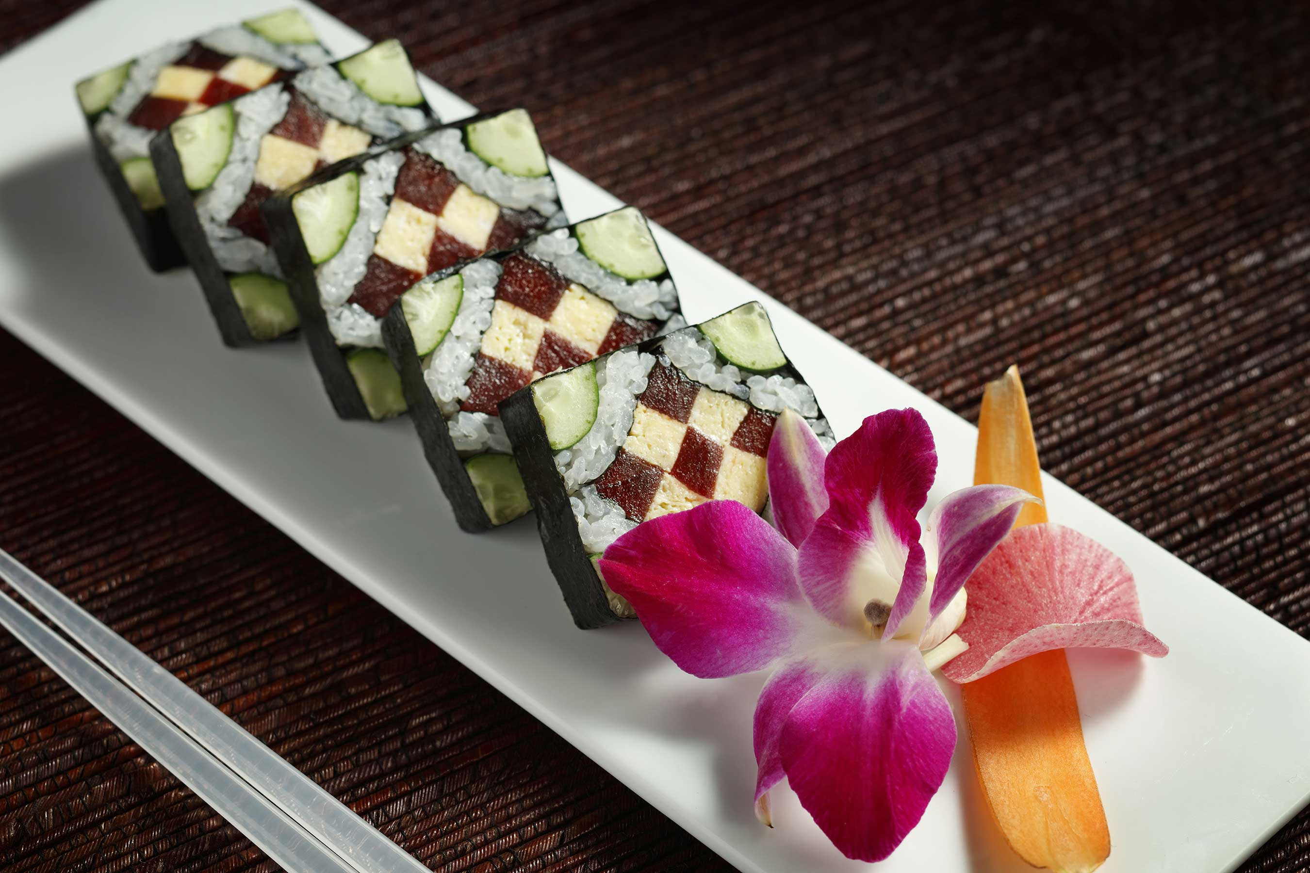 "Known as ""Morimoto Stained Glass Window Sushi Rolls,"" the Chef's Combination combines various ingredients to create a picturesque work-of-art."