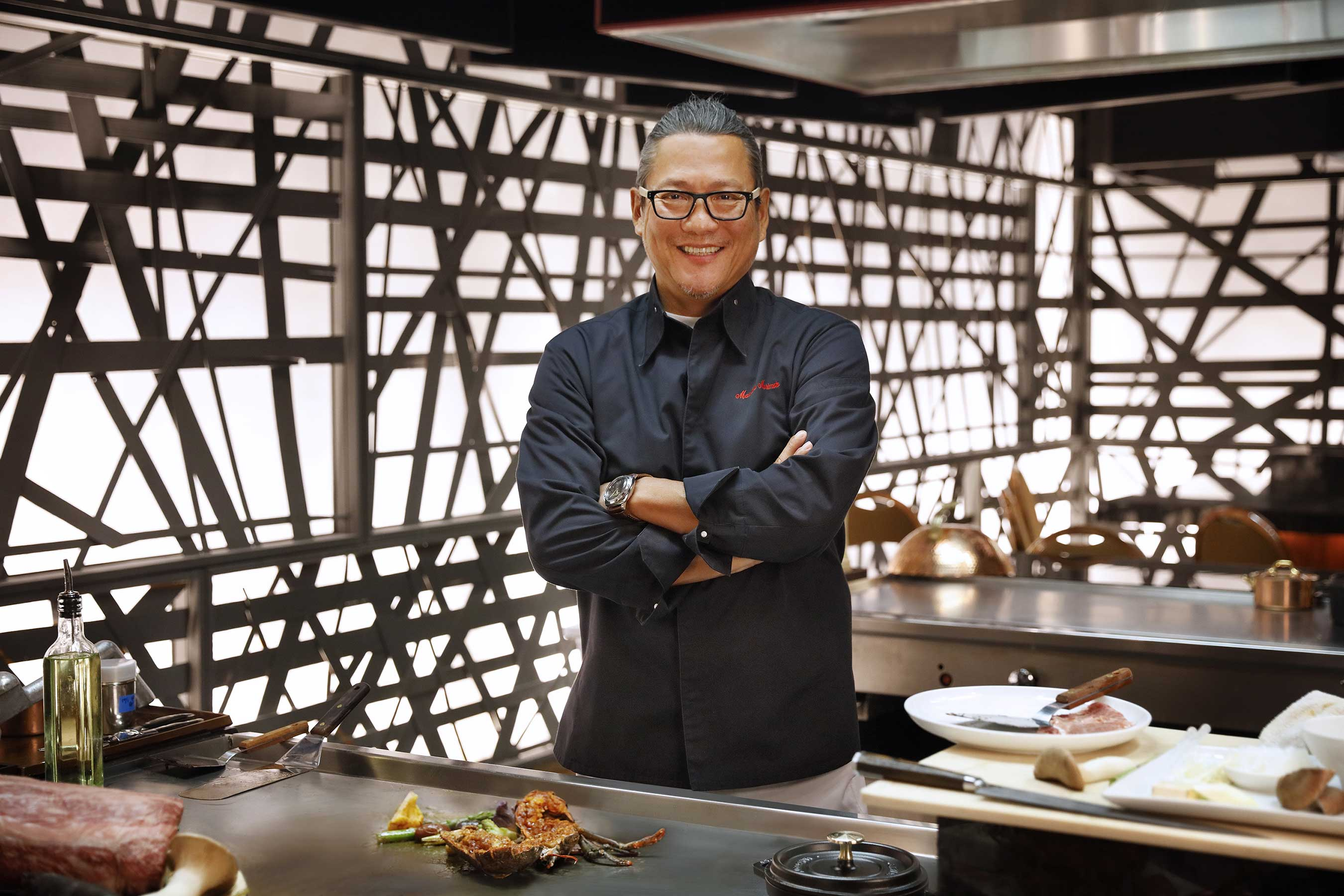 Chef Morimoto brings showmanship to Morimoto Las Vegas with his first Teppan table experience.