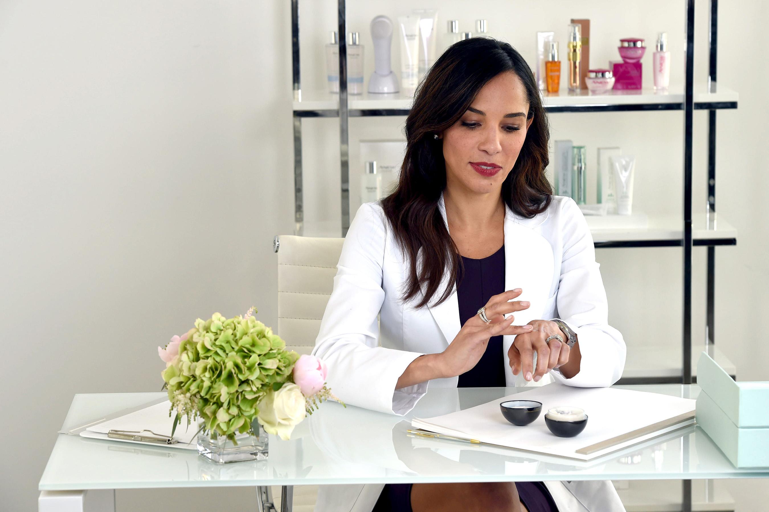 Dr. Nichols testing out Avon ANEW Ultimate Supreme Advanced Performance Crème.