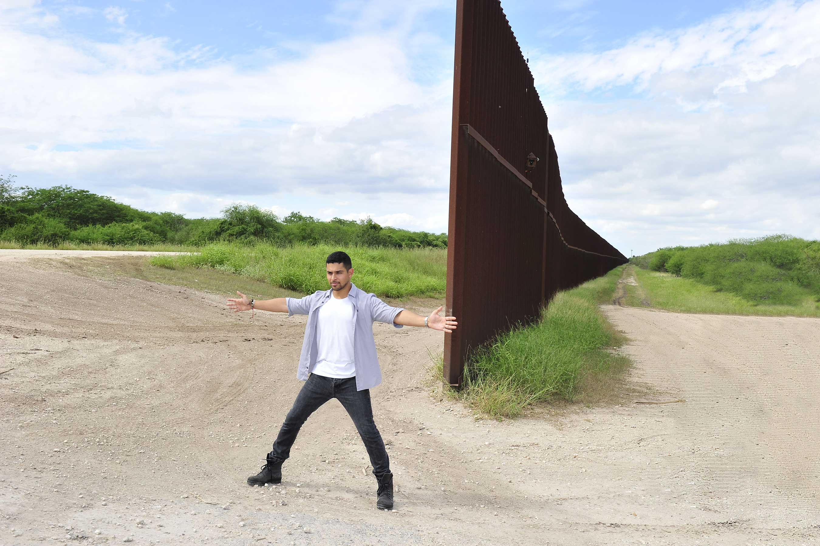Wilmer Valderrama visits the US-Mexico border fence to take a stand for cultural progress in support of Johnnie Walker's Keep Walking America campaign (Michael Simon).