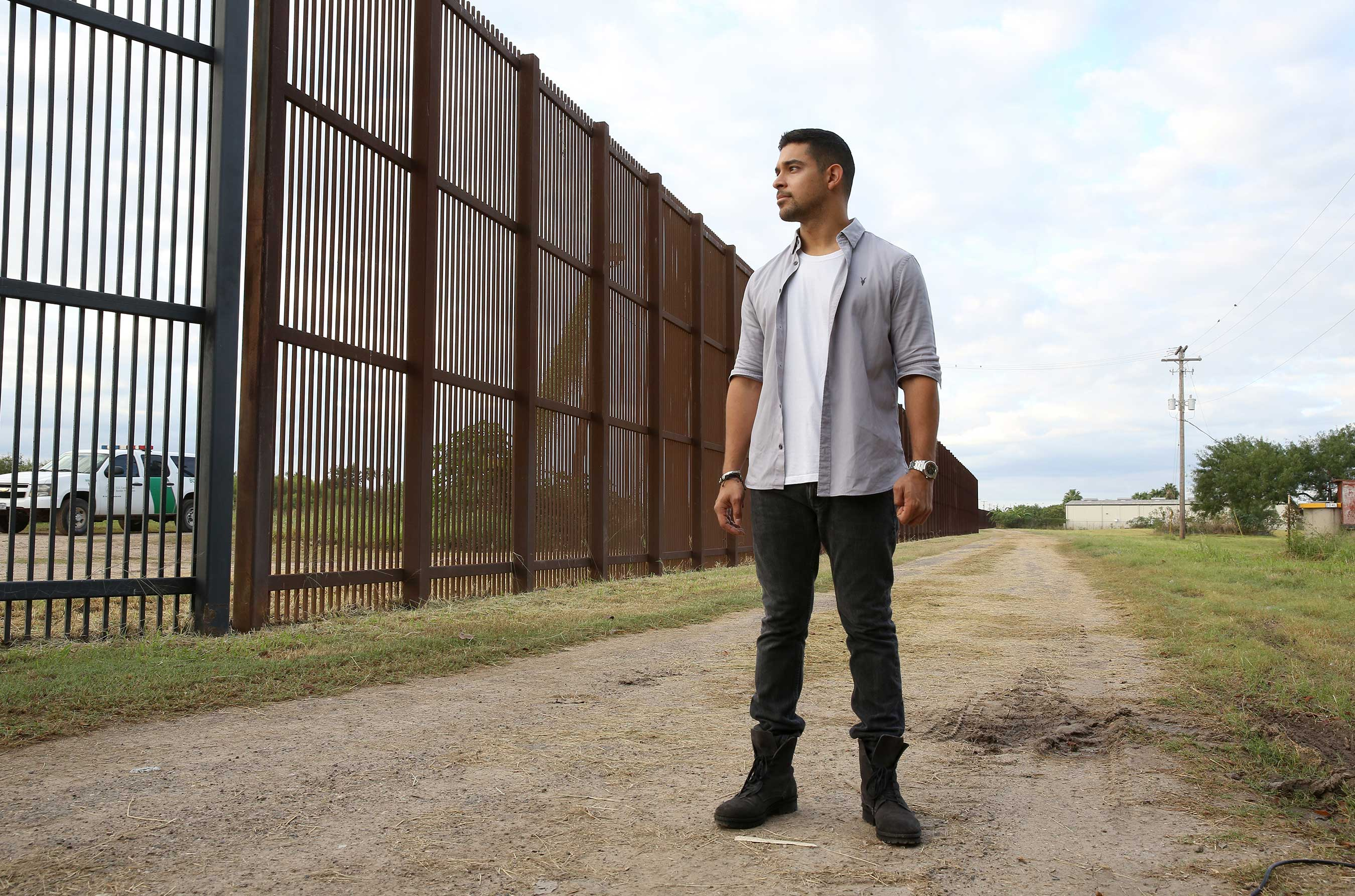 Wilmer Valderrama visits the US-Mexico border fence to take a stand for cultural progress in support of Johnnie Walker's Keep Walking America campaign (Rachel Murray/Getty Images).