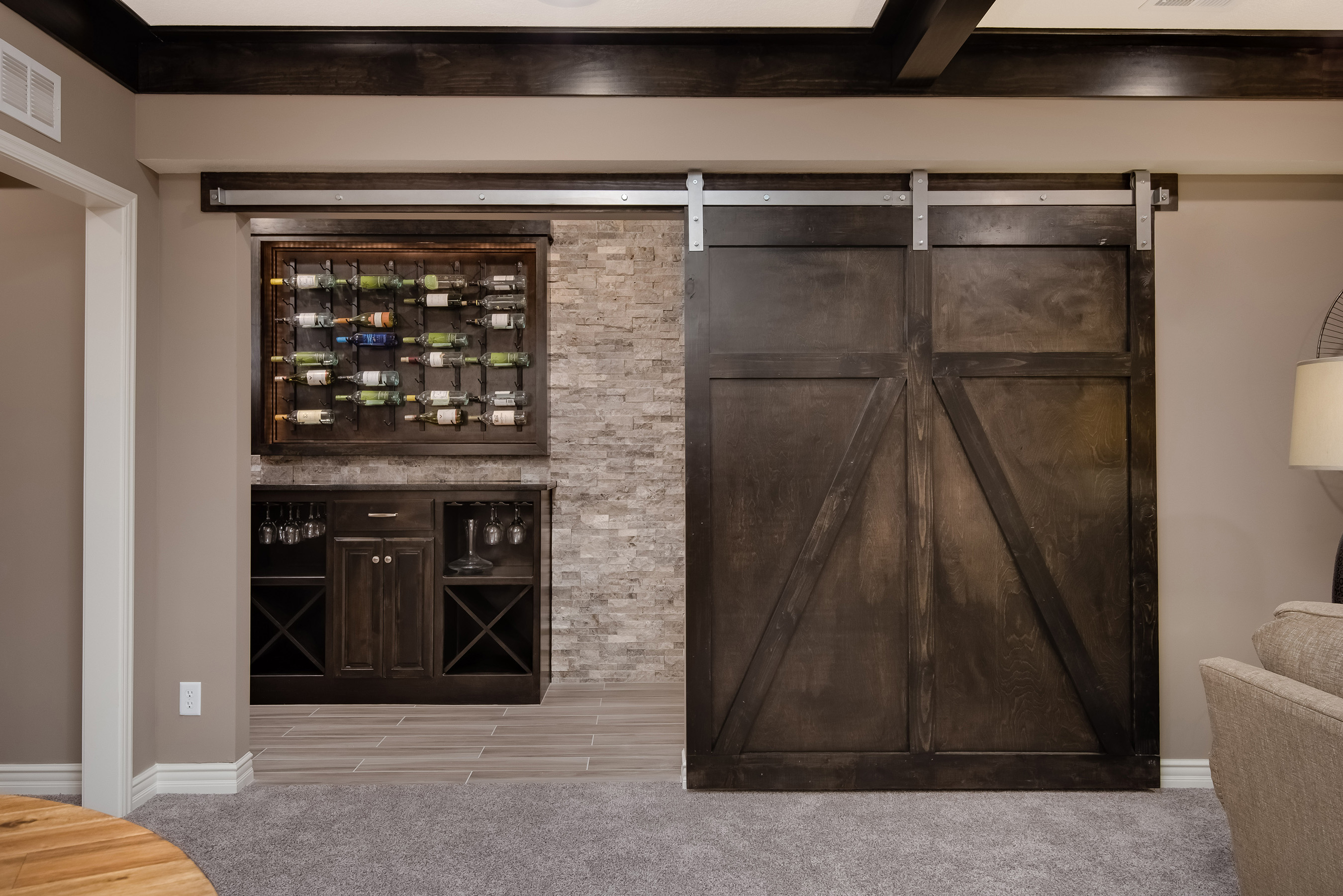 Summit Custom Homes feature innovative design elements and storage features like a wine rack and bar with sliding barn door.