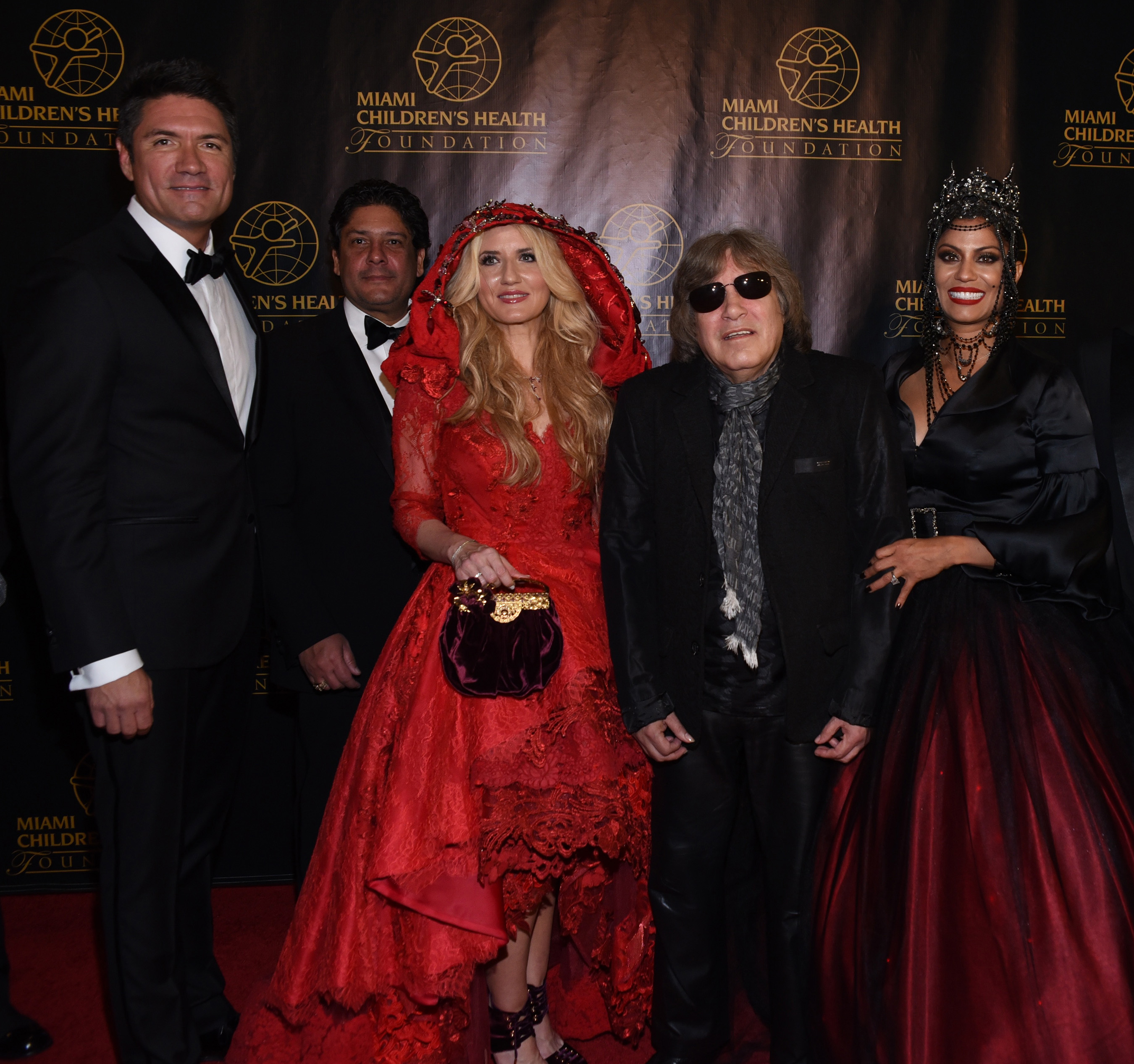 Louis Aguirre, Master of Ceremonies, Jorge Luis and Marile Lopez, Board Chair of Miami Children's Health Foundation, Jose Feliciano, Pediatric Hall of Fame inductee and Lucy Morillo