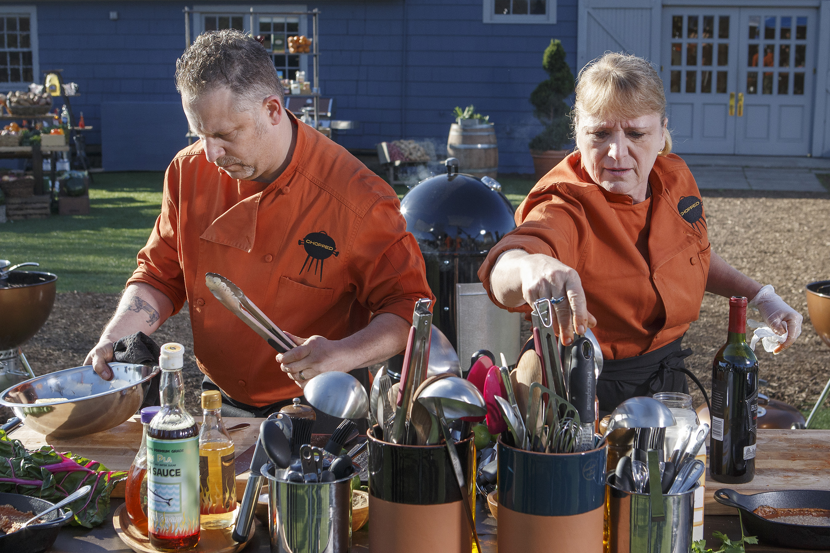 Contestants competing on Food Network's Chopped Grill Masters