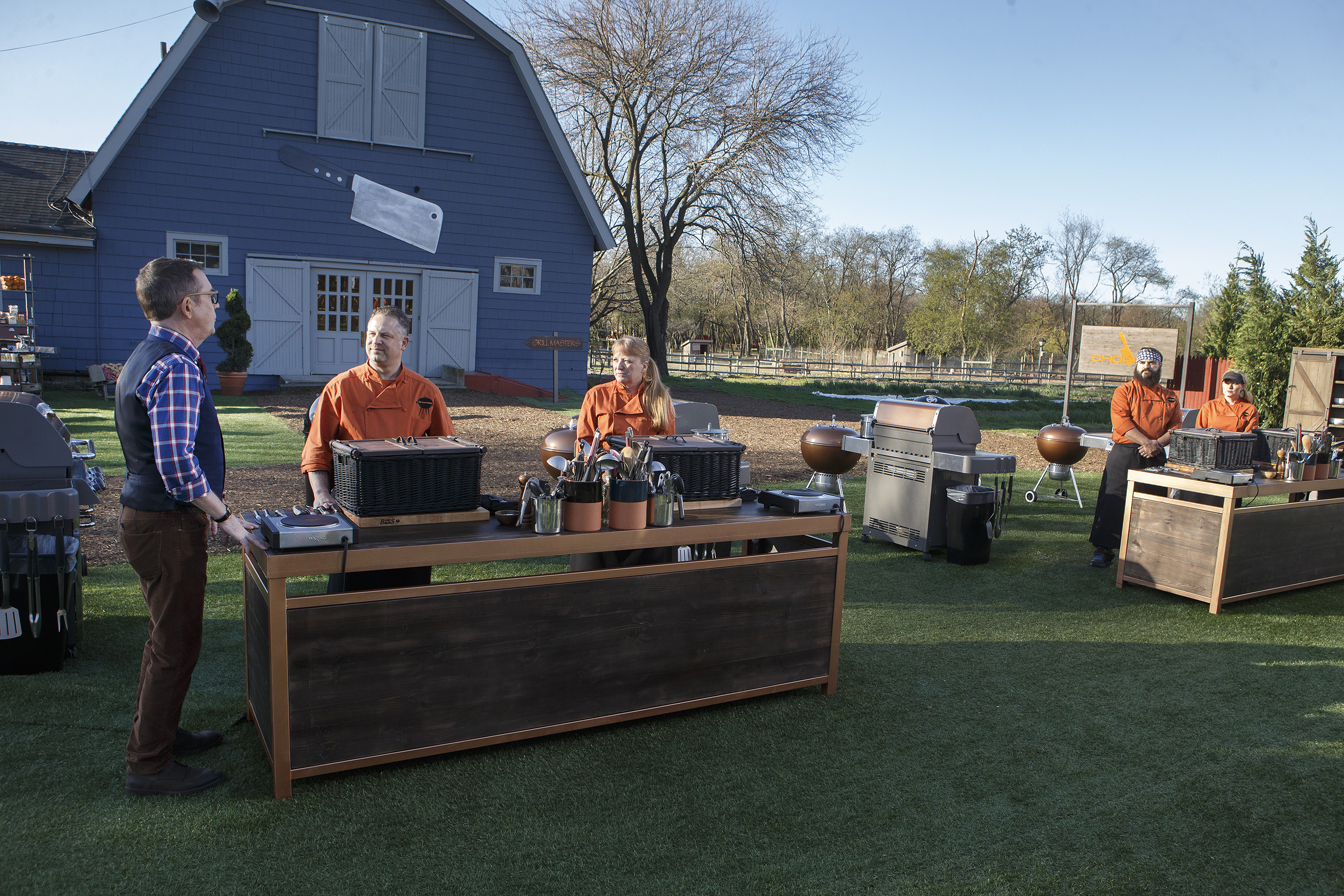 Host Ted Allen talks to the contestants on Food Network's Chopped Grill Masters