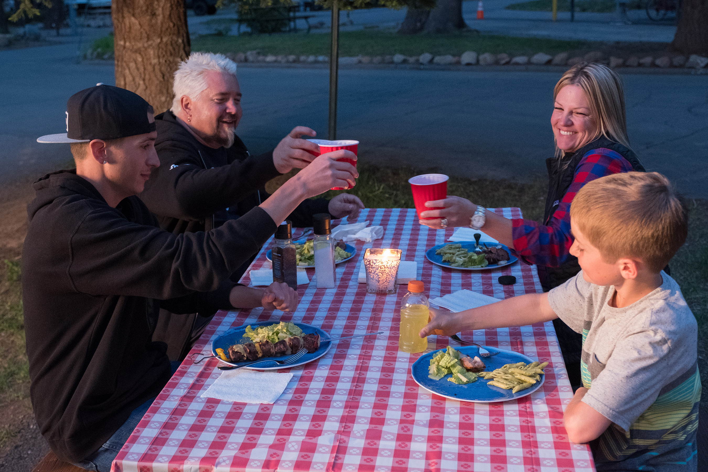 Hunter, Guy, Lori and Ryder Fieri enjoying a family dinner on the road on Food Network's Guy's Family Road Trip