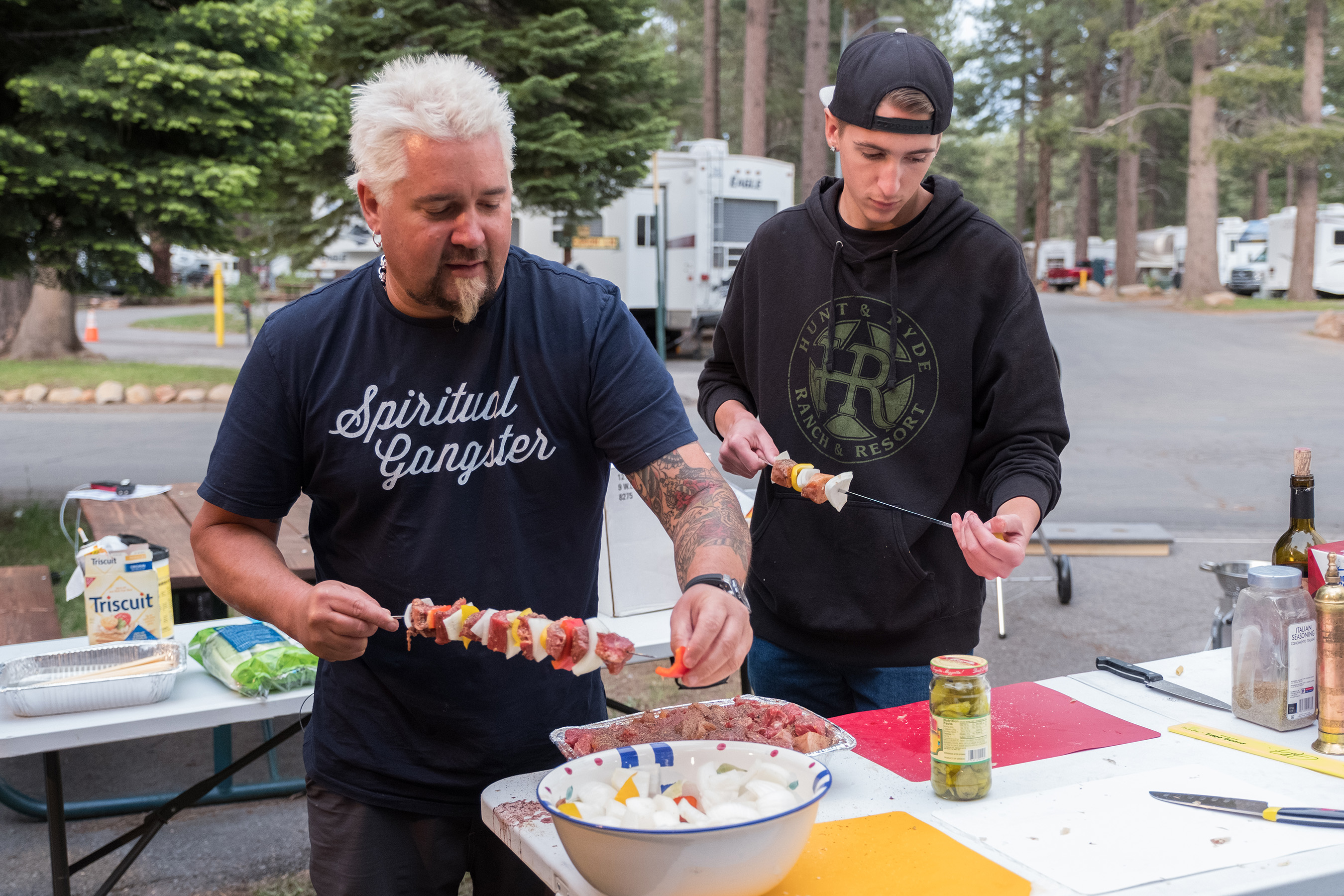 Guy and Hunter Fieri getting ready to grill on Food Network's Guy's Family Road Trip