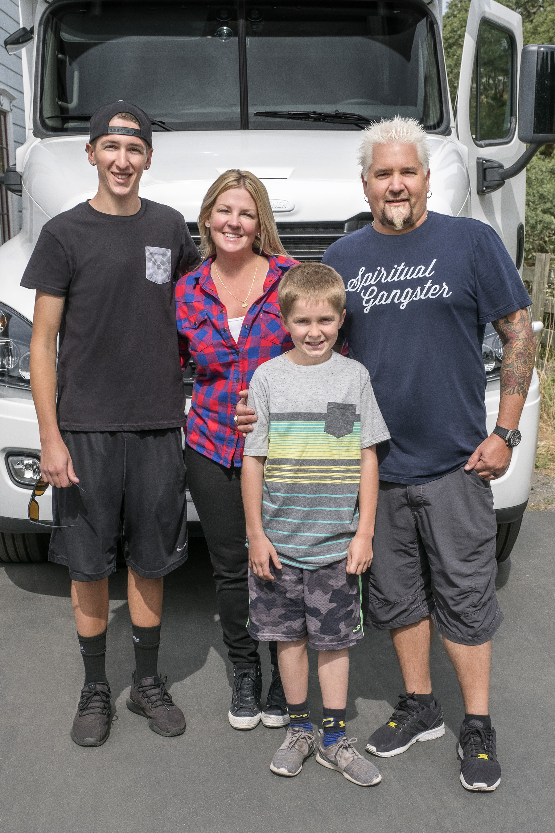 Hunter, Lori, Guy and Ryder Fieri pose on Food Network's Guy's Family Road Trip