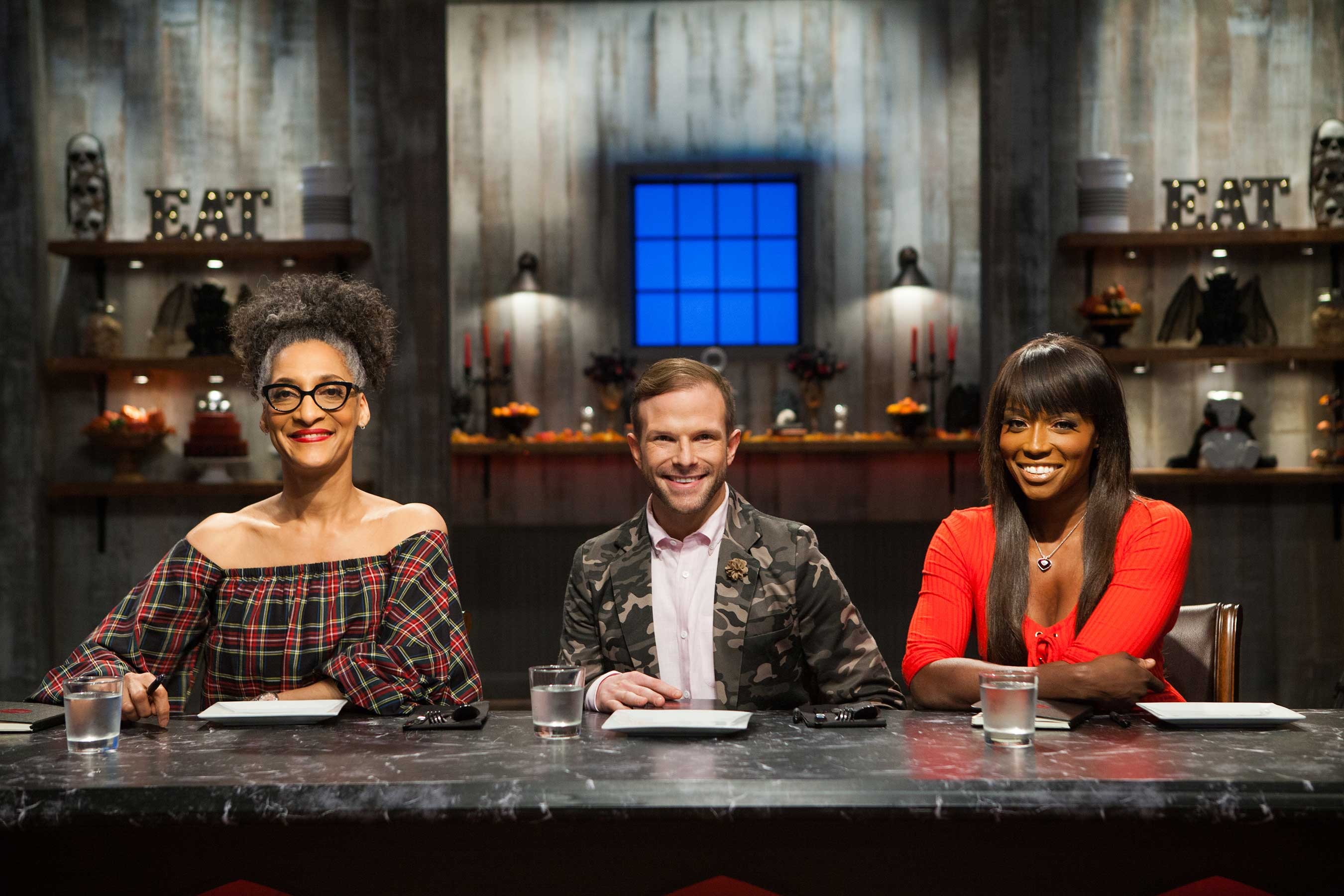 Judges Carla Hall, Zac Young, and Lorraine Pascale on Food Network's Halloween Baking Championship