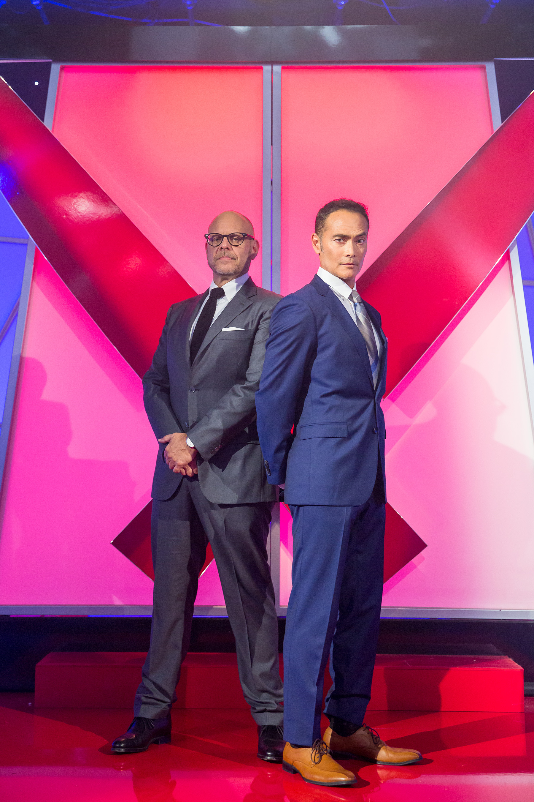 Host Alton Brown and The Chairman on Food Network's Iron Chef Showdown