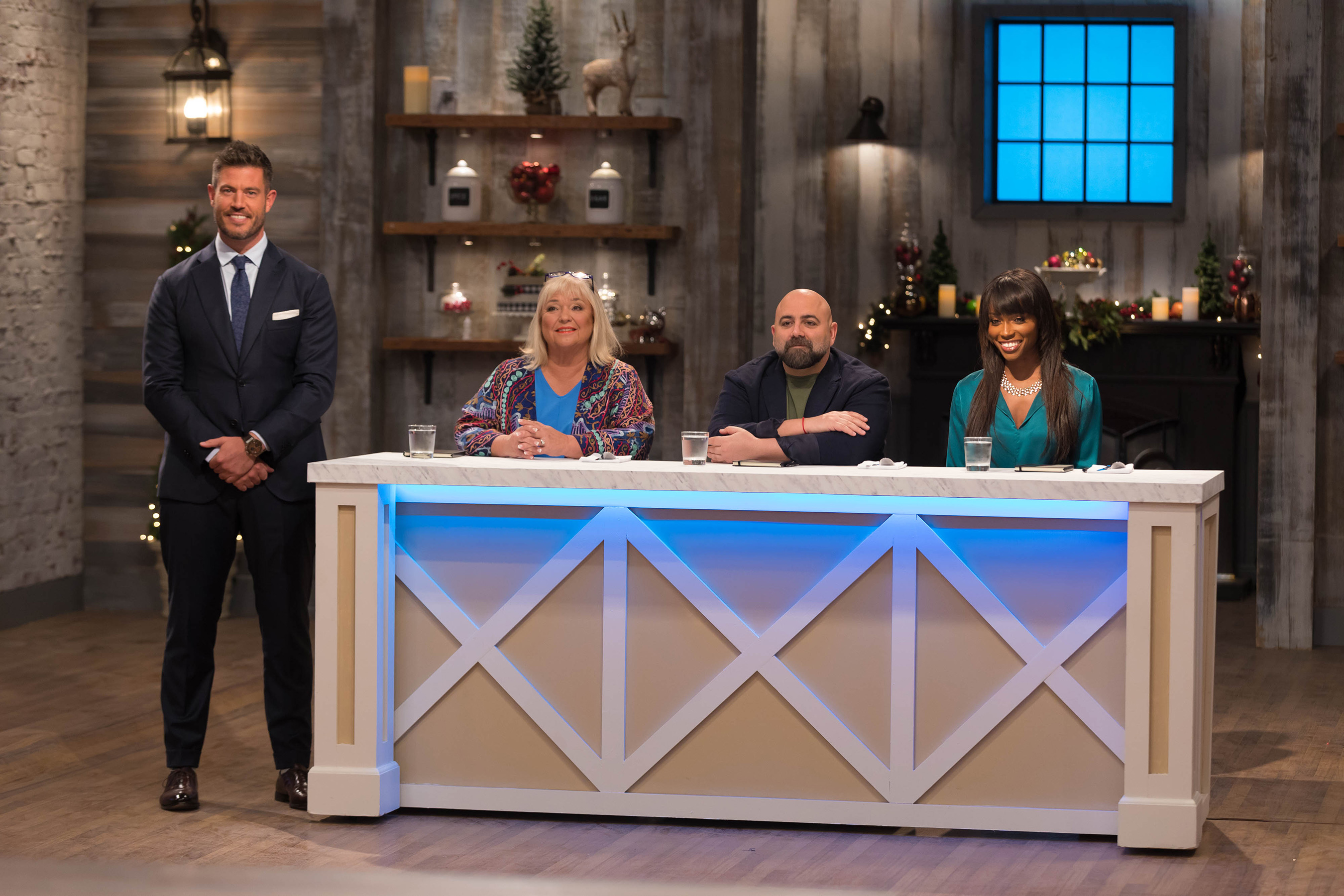 Host Jesse Palmer with judges Nancy Fuller, Duff Goldman and Lorraine Pascale on Food Network's Holiday Baking Championship