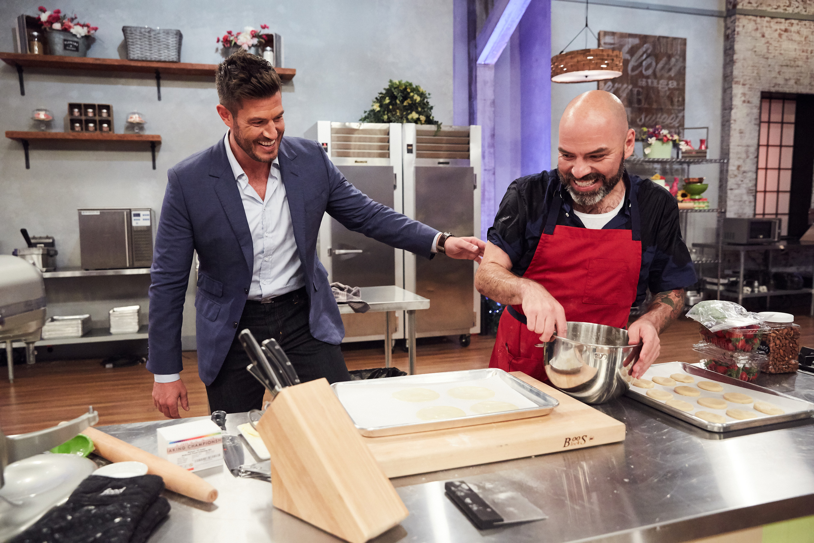 Host Jesse Palmer checks in on competitor Fausto Barragan on Food Network's Spring Baking Championship