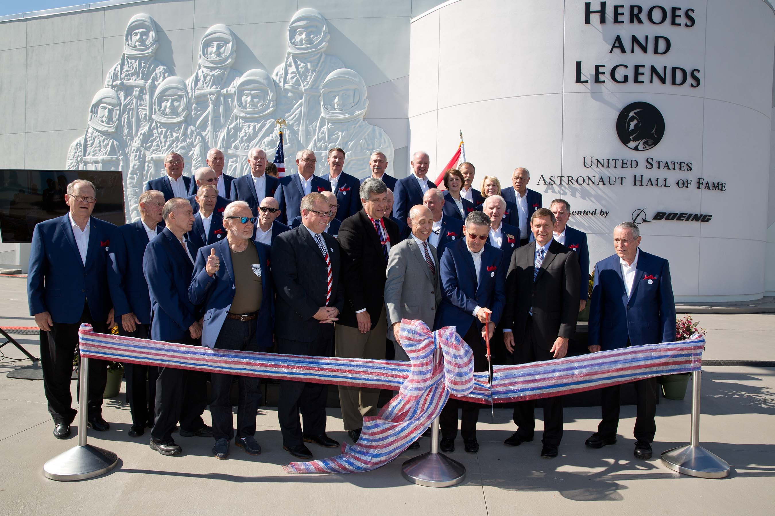 Representatives of NASA, Boeing and Delaware North, which operates Kennedy Space Center Visitor Complex for NASA, are joined by 25 Hall of Fame astronauts from the Mercury, Gemini, Apollo and Space Shuttle programs to celebrate the opening of Heroes & Legends featuring the U.S. Astronaut Hall of Fame presented by Boeing.
