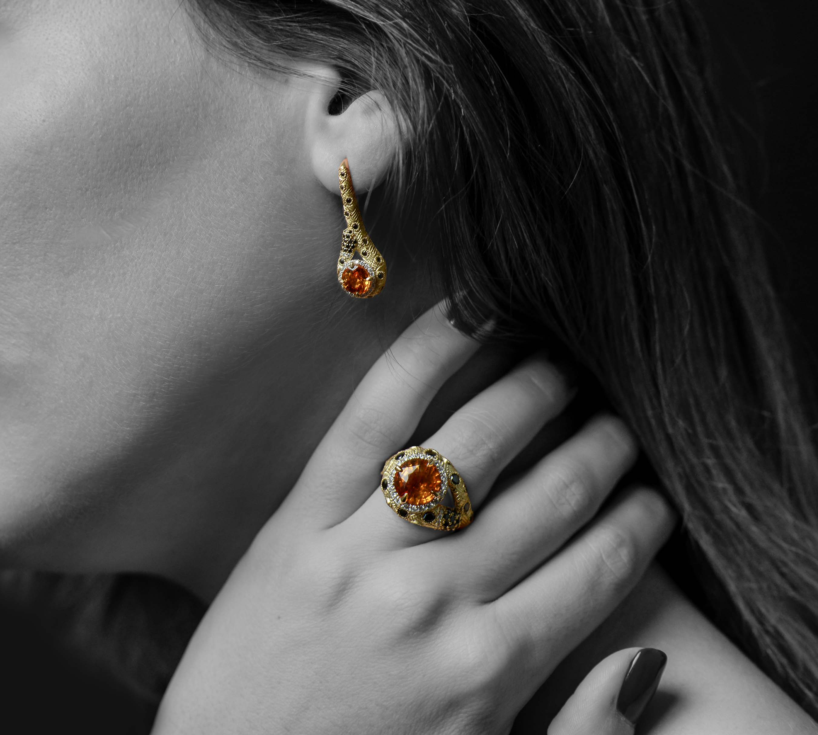 The dazzling Eye of the Cheetah 18k yellow gold ring boasts a magnificent 4.7 carat orange sapphire, and these one-of-a-kind pieces are adorned in more than 190 black and white diamonds. $20,000.00