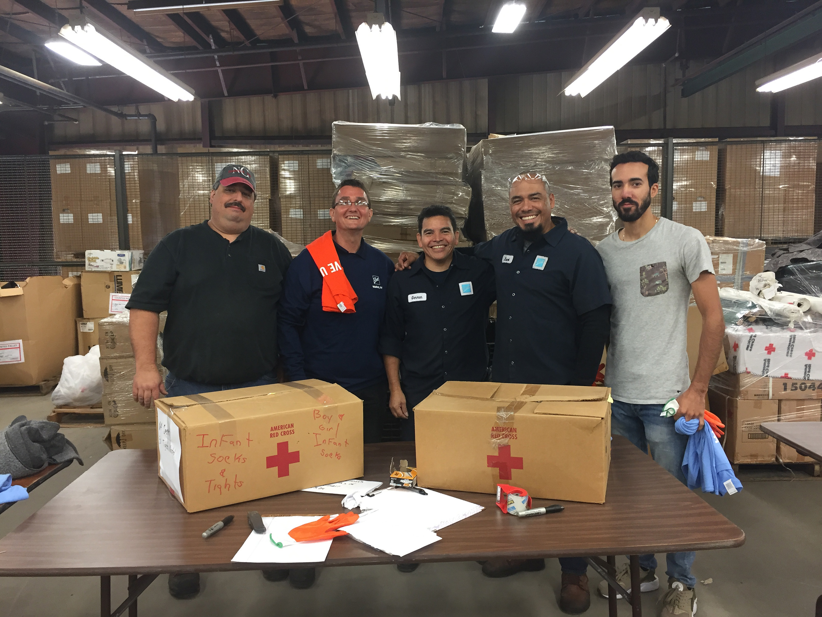 Employees from Ball's Wallkill, New York, beverage packaging manufacturing plant compiled care packages for the American Red Cross in their community as part of the 9/11 Day of Remembrance.