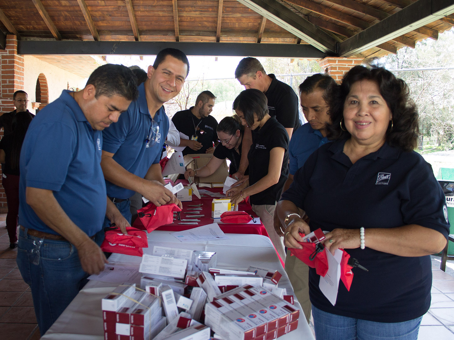 Ball employees from Queretaro, Mexico, and executives partnered together to build first aid kits for the Mexican Red Cross to distribute to those in need across the country.