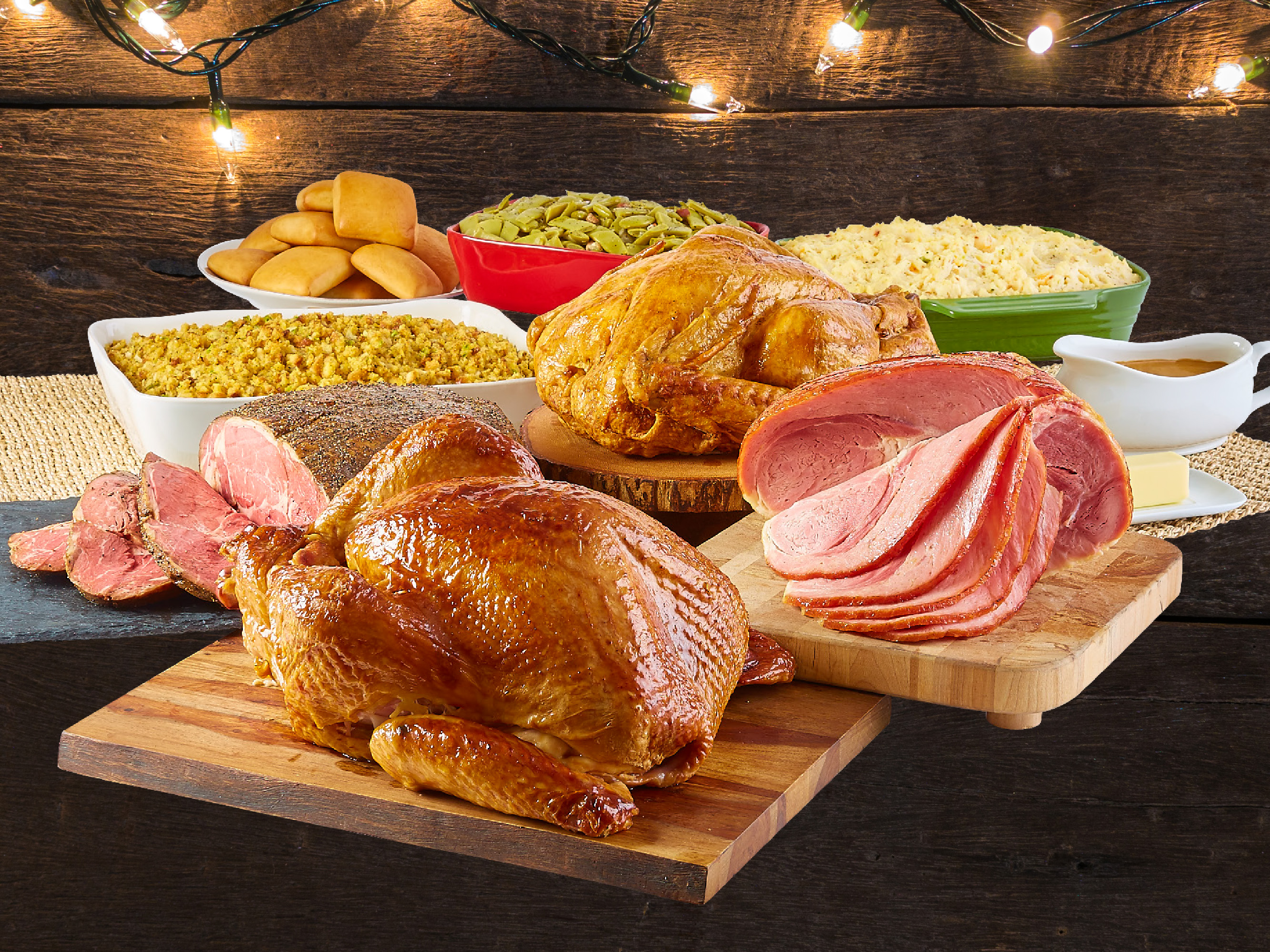 Dickey's Holiday Feasts includes the guests choice of meat with baked potato casserole, green beans, cornbread dressing and buttery rolls.