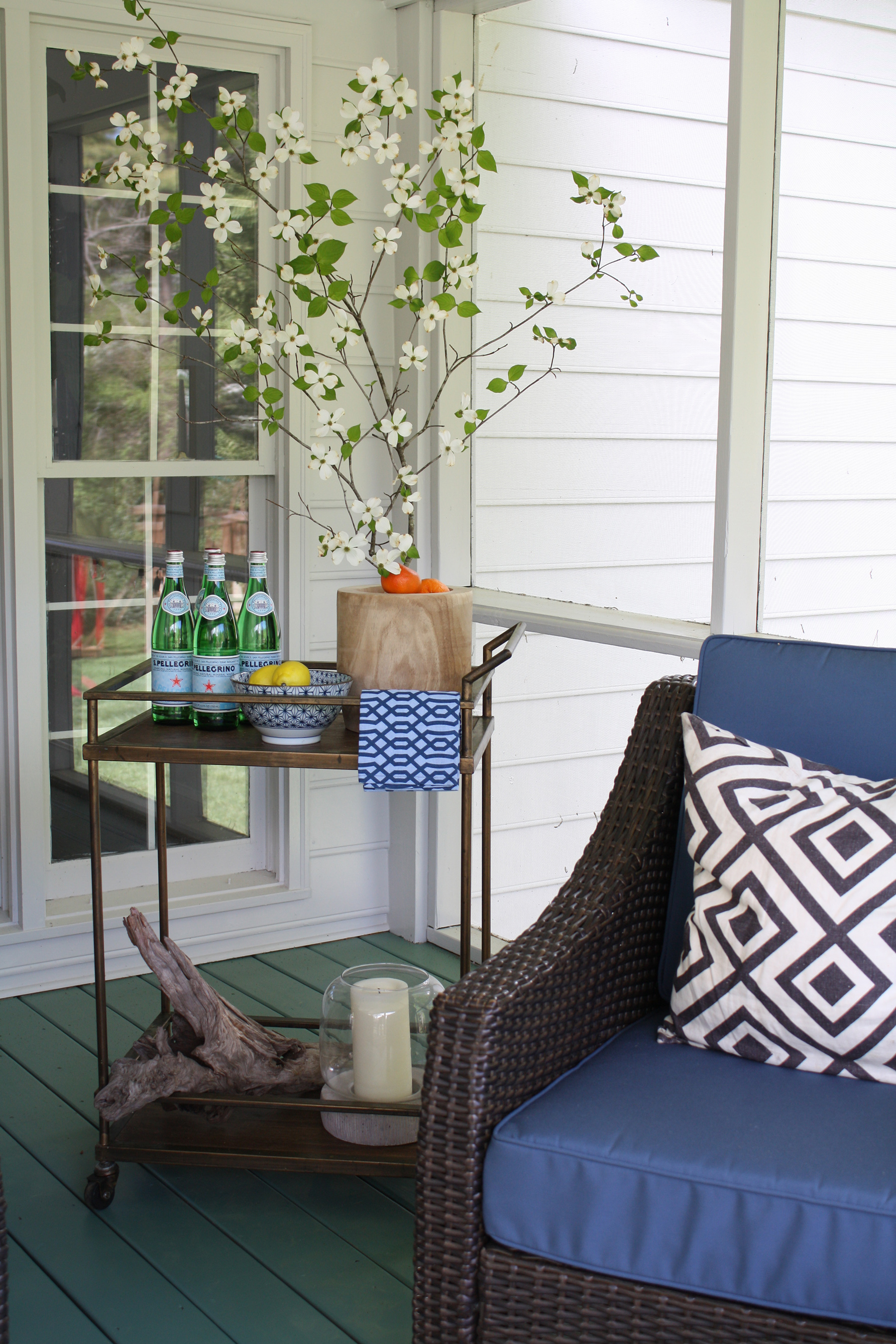 Emily Clark from the blog Emily A. Clark wins $5,000 for the St. Jude Children's Research Hospital through FrogTape® Paintover Challenge® room makeover contest with her screened-in porch transformation.
