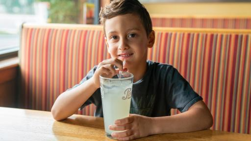 Boy drinking lemonade.