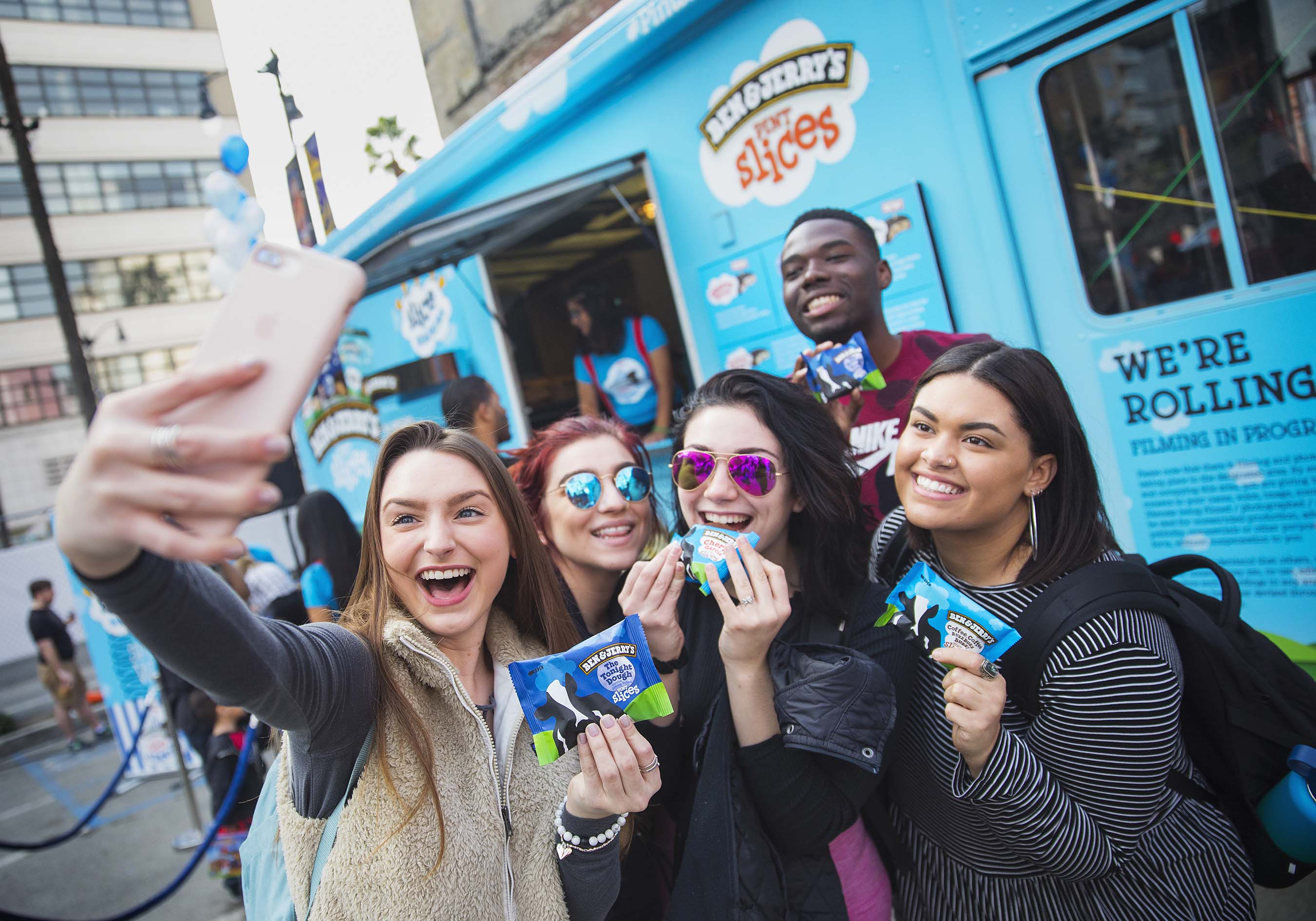 Fans celebrate the introduction of three new pint slice flavors at a pop-up pint slice carnival in Hollywood.