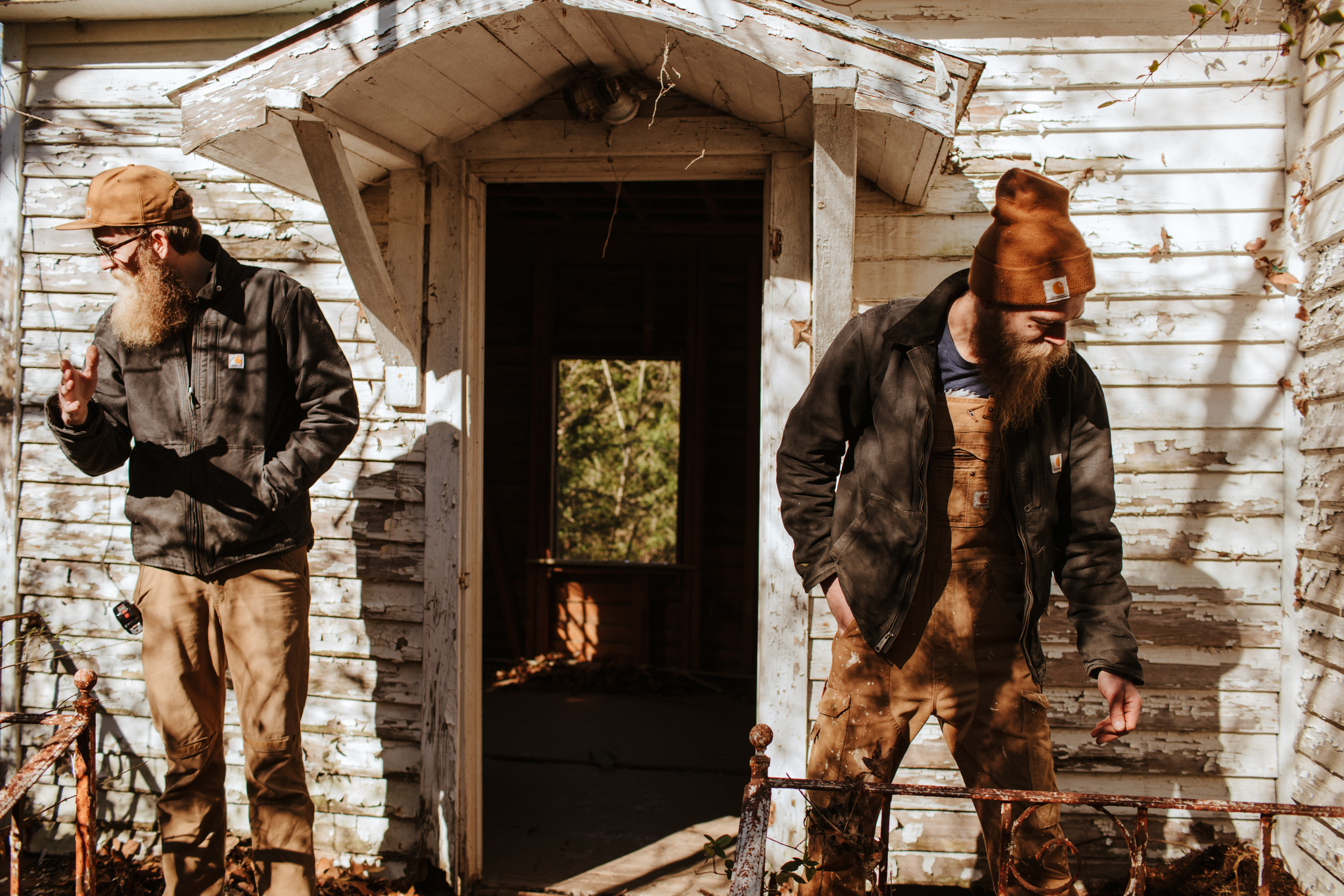 Matt and Ben Hobbes of Sons of Sawdust examine an old home as they search for reclaimed wood; a craft they learned from their grandfather when they were young.