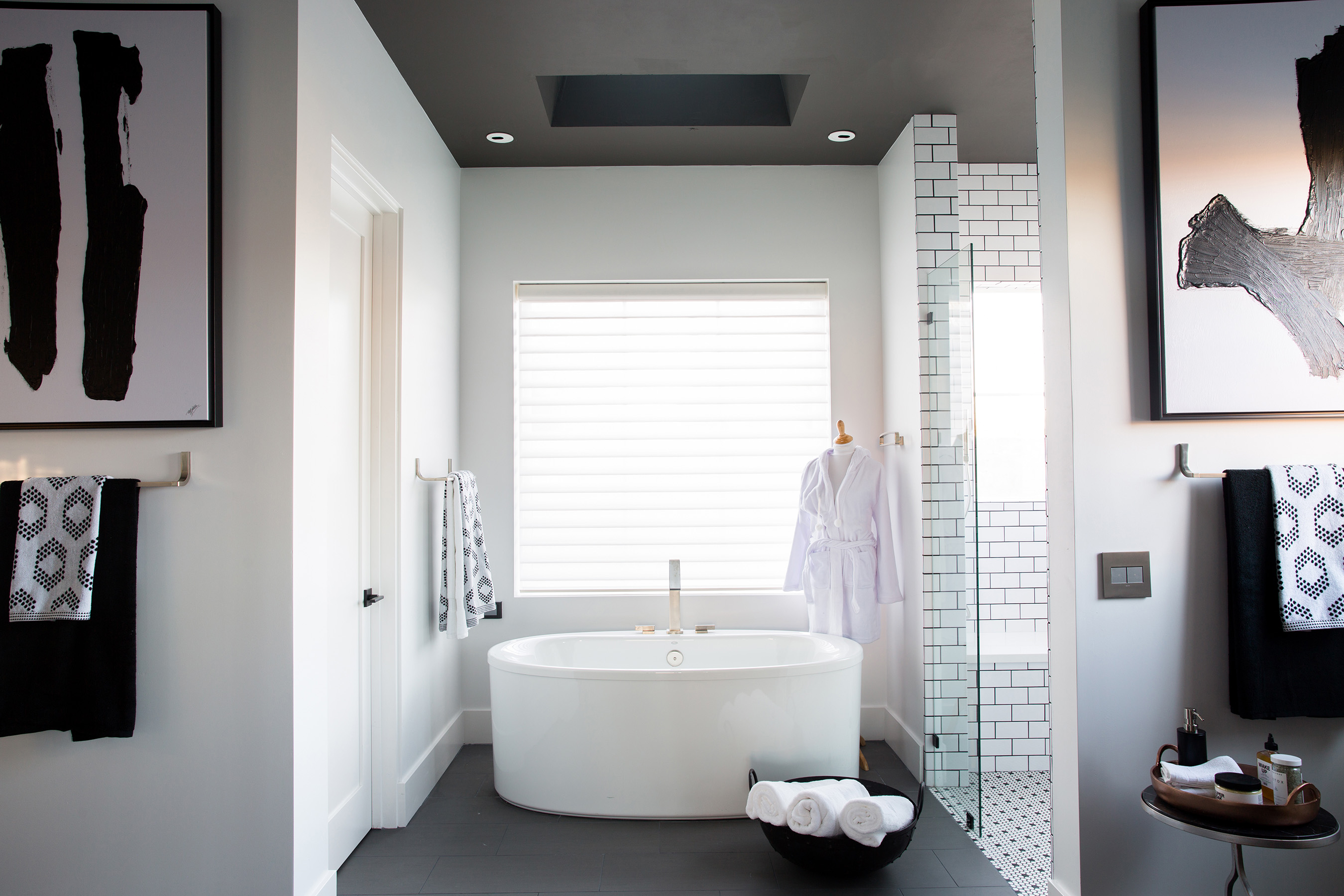 The master bath in the HGTV Smart Home 2017 is a spa-like room tricked out with tons of technology from the tub to the shower to the toilet. The black-and-white color scheme is simple yet stunning. Two sizes of white subway tile contrast with a dark gray grout while floating vanities feature graphic hardware and ultra-modern faucets.