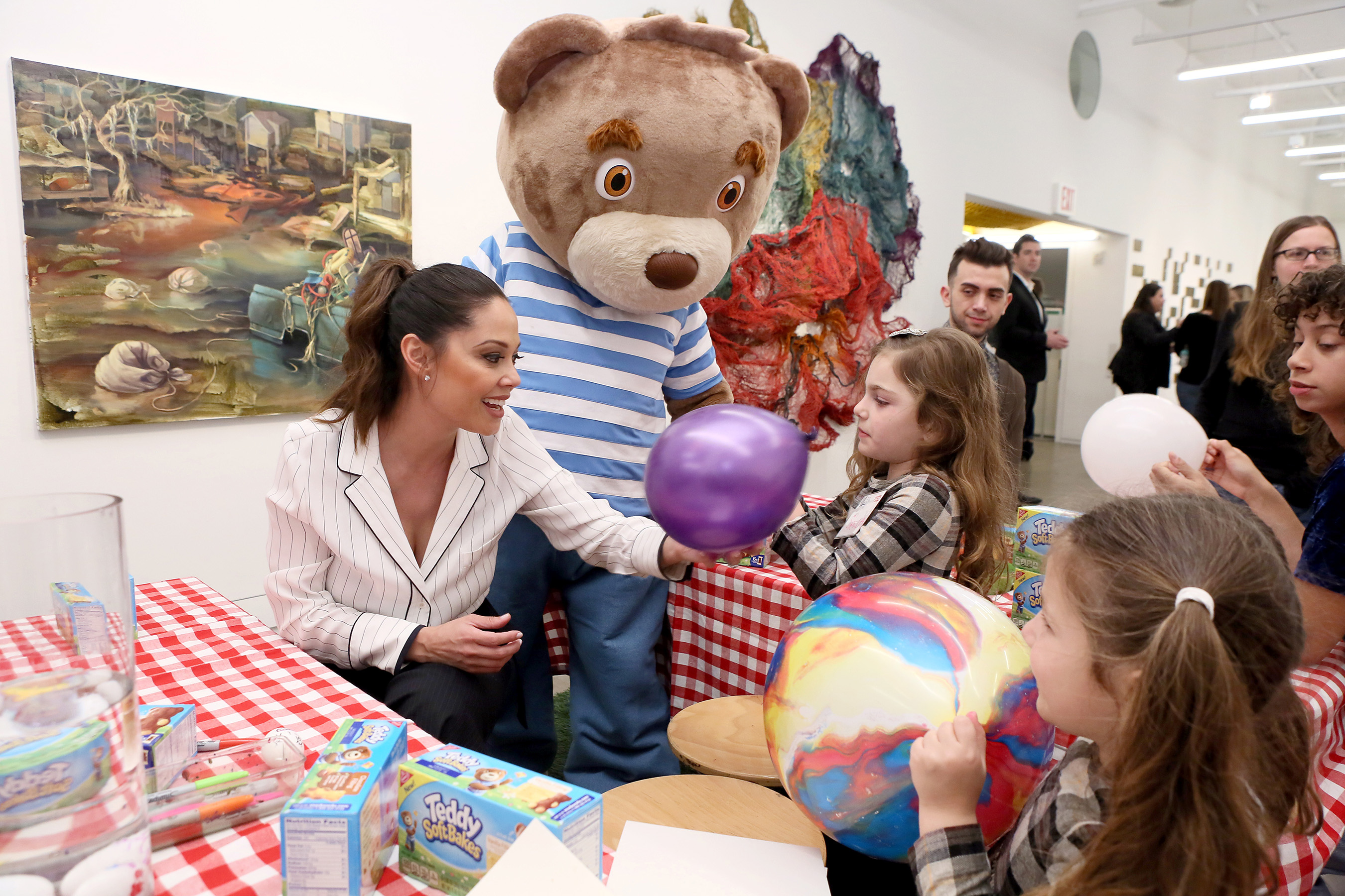 Vanessa Lachey, left, mom of three, had fun celebrating the launch of TEDDY Soft Bakes while participating in the brand's discovery activities at the Children's Museum of the Arts on Wednesday, Feb. 15, 2017, in New York City. (Stuart Ramson/AP Images for Mondelez International)