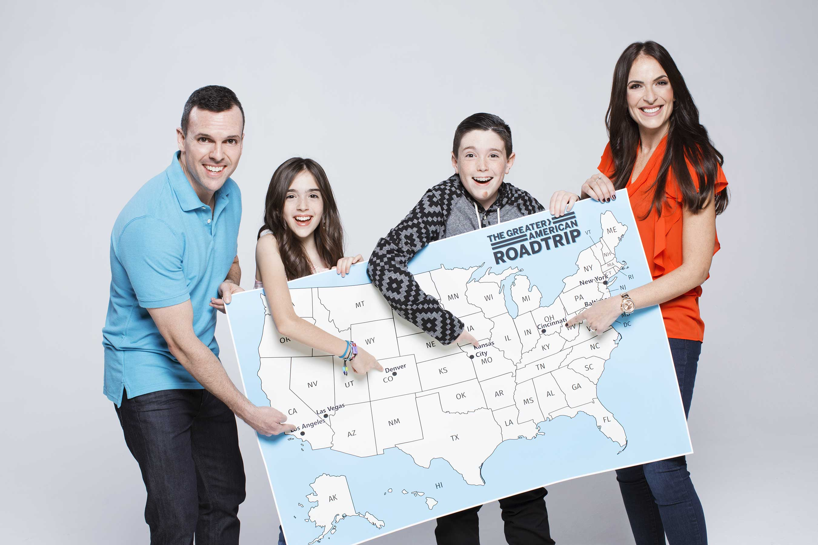The Eh Bee Family study the Greater American Road Trip Map