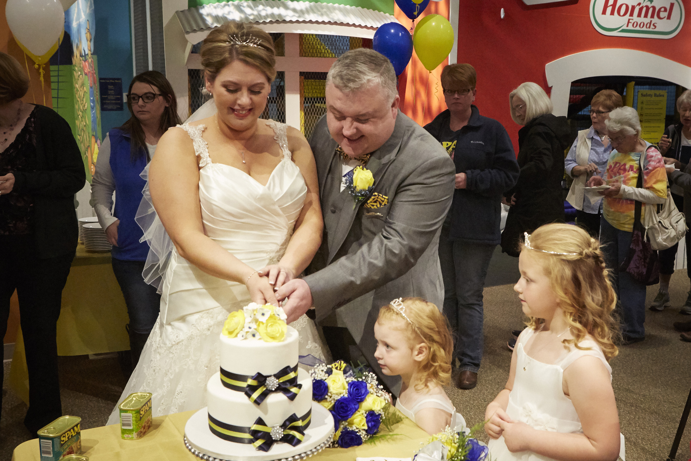 The newlyweds cutting their cake following the ceremony at the SPAM Museum