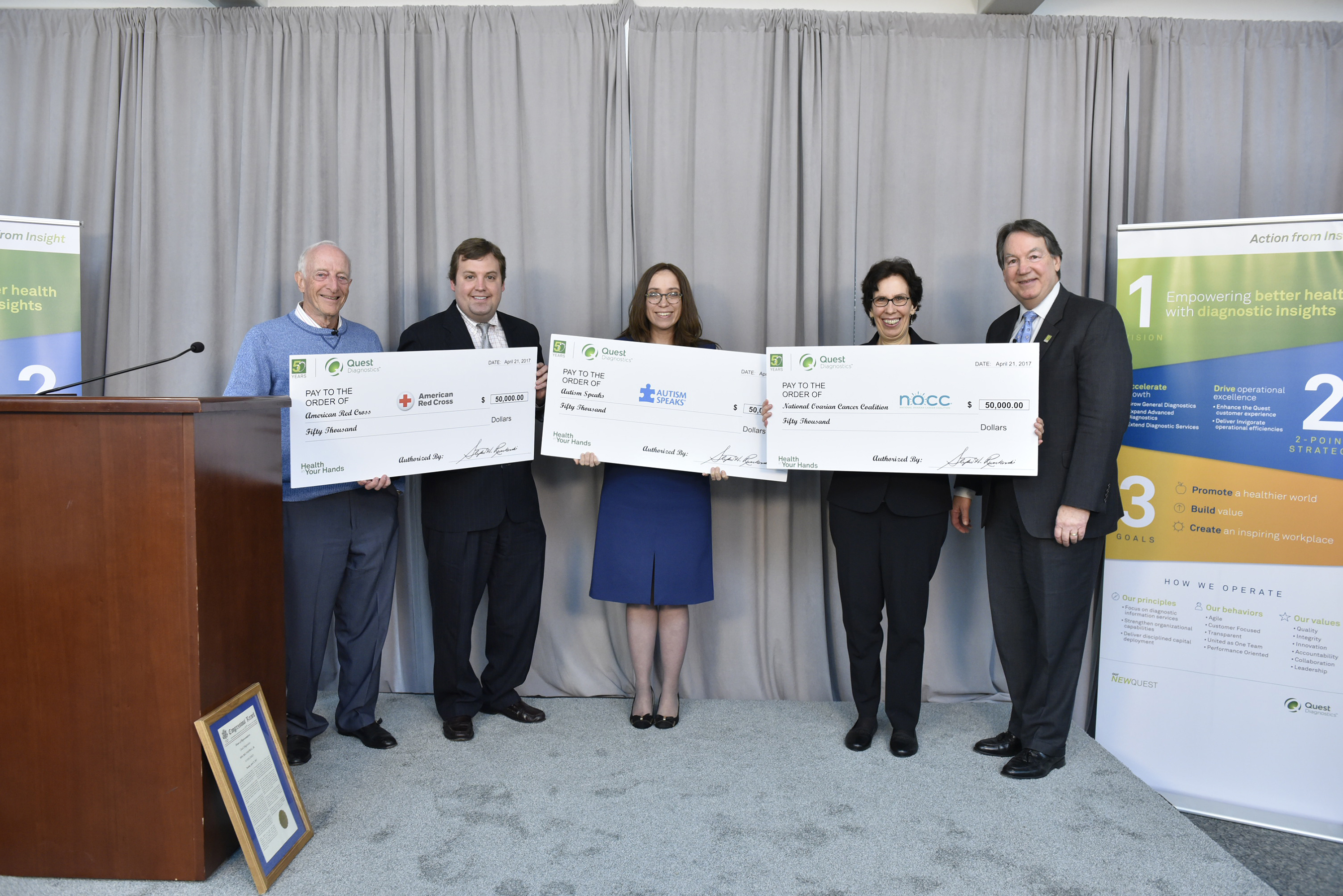 Representatives from the American Red Cross, National Ovarian Cancer Coalition and Autism Speaks accept their Health In Your Hands Grants in celebration of Quest's 50th anniversary