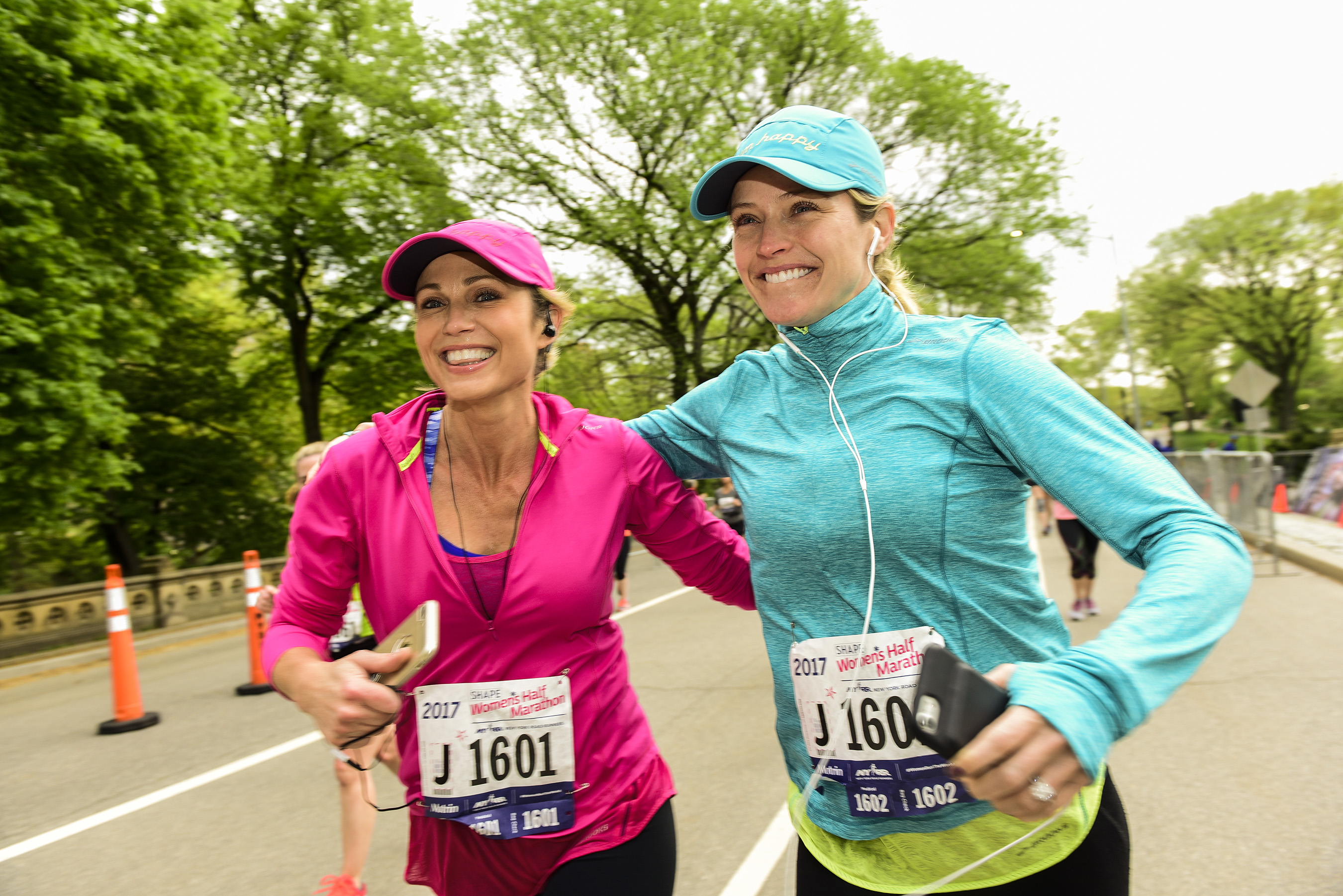 Amy Robach and Sara Haines run alongside each other at the 2017 SHAPE Women's Half Marathon in Central Park on Sunday, April 30, 2017