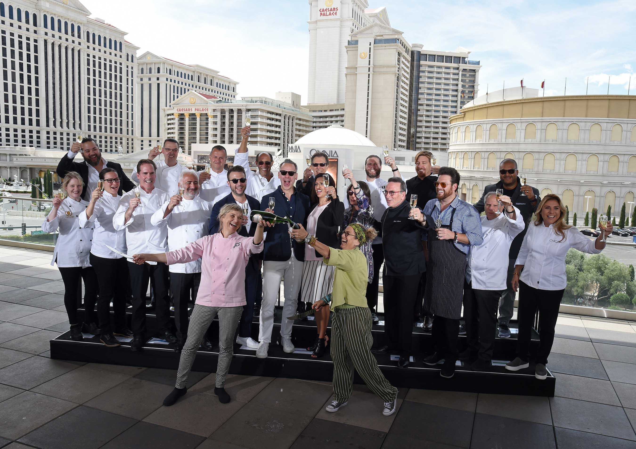 Chefs Susan Feniger and Mary Sue Milliken mark the beginning of Vegas Uncork'd by Bon Appétit with a champagne saber-off at The LINQ Hotel & Casino in Las Vegas (credit Ethan Miller, Getty Images)