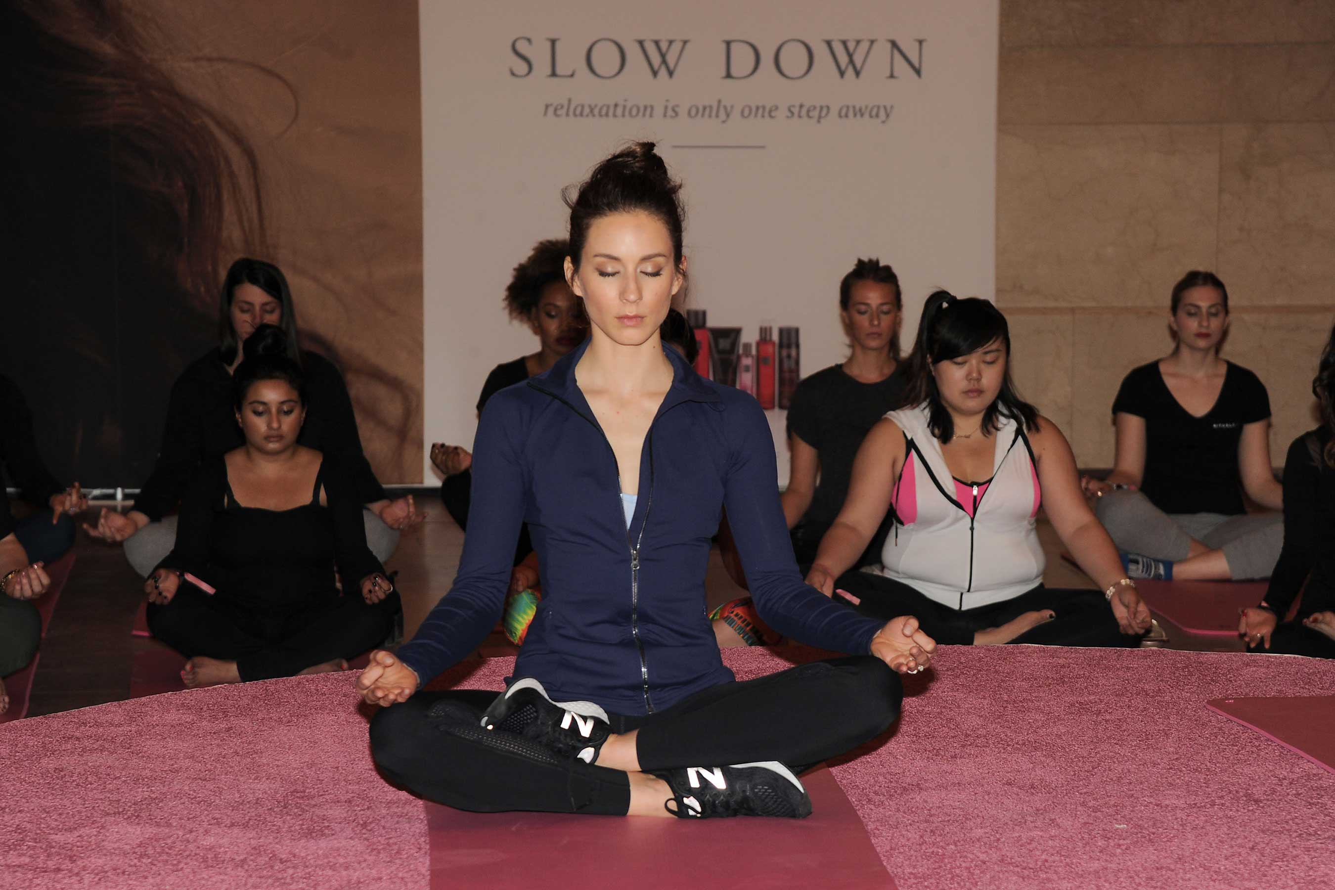 Troian Bellisario meditating with Rituals Cosmetics in Grand Central Terminal in NYC for #slowdown campaign