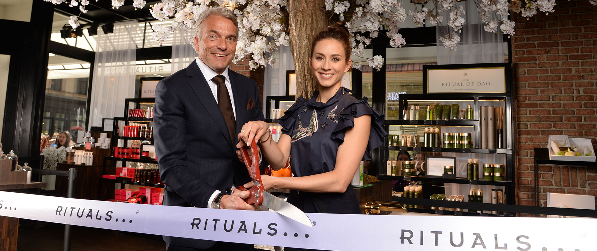 Troian Bellisario and Raymond Cloosterman, CEO Rituals Cosmetics, cutting the ribbon at Rituals Fifth Avenue Store in NYC