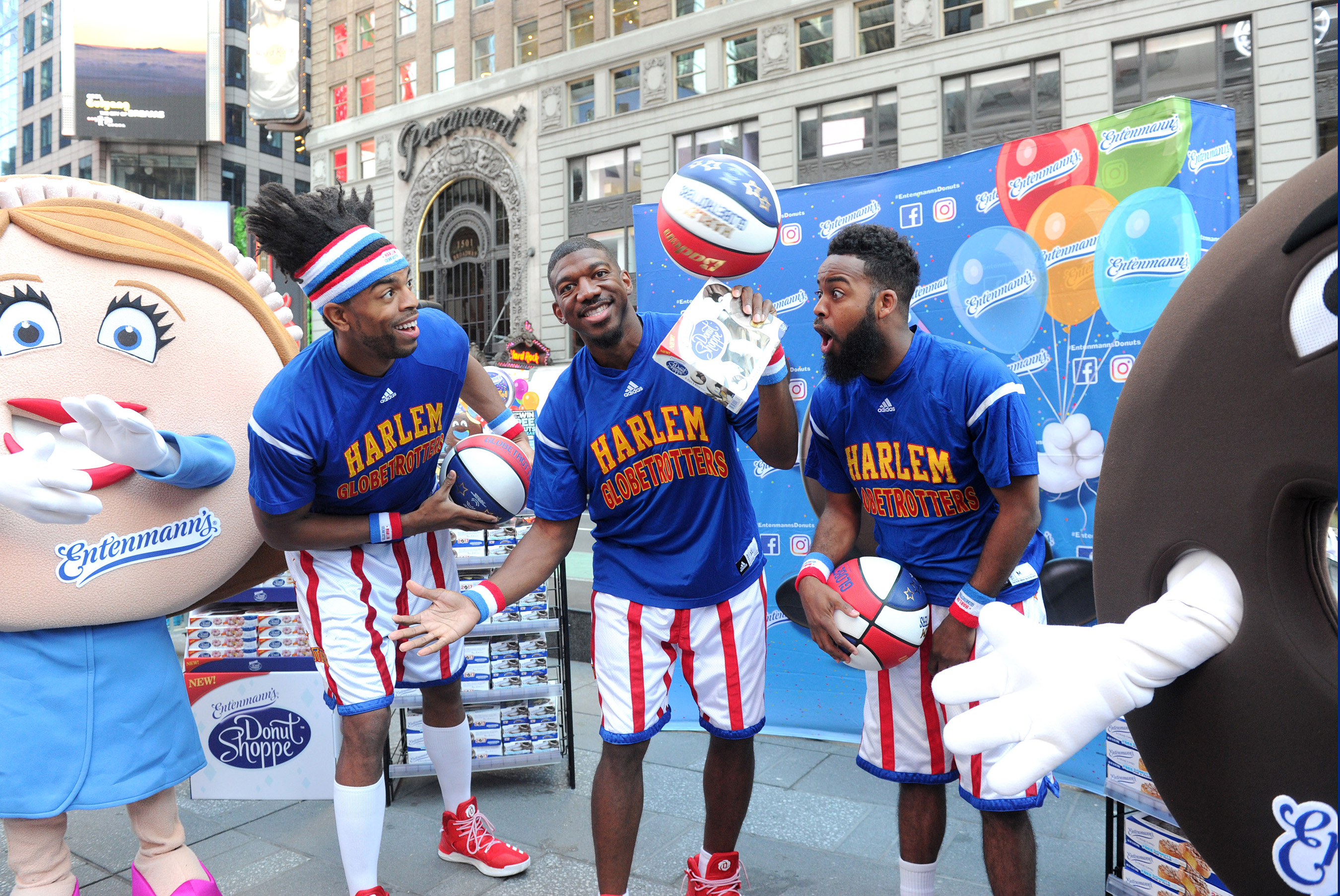 Entenmann's teams up with the world famous Harlem Globetrotters to celebrate National Donut Day in New York's Times Square, Friday, June 2, 2017. Over 40,000 Entenmann's Rich Frosted Donuts were handed out to fans across the city.