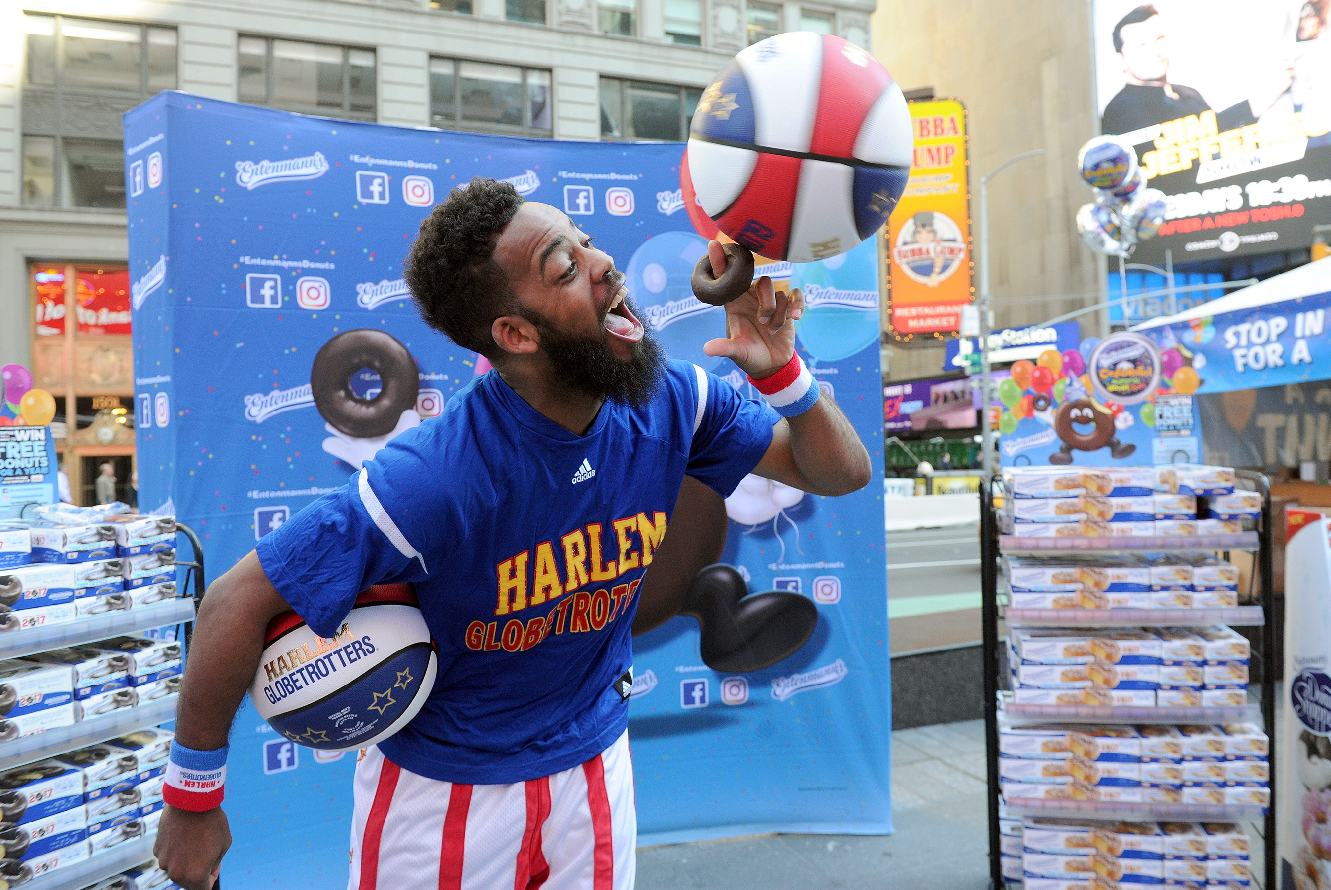 Ant, of the world famous Harlem Globetrotters, celebrates National Donut Day with Entenmann's in New York's Times Square, Friday, June 2, 2017.
