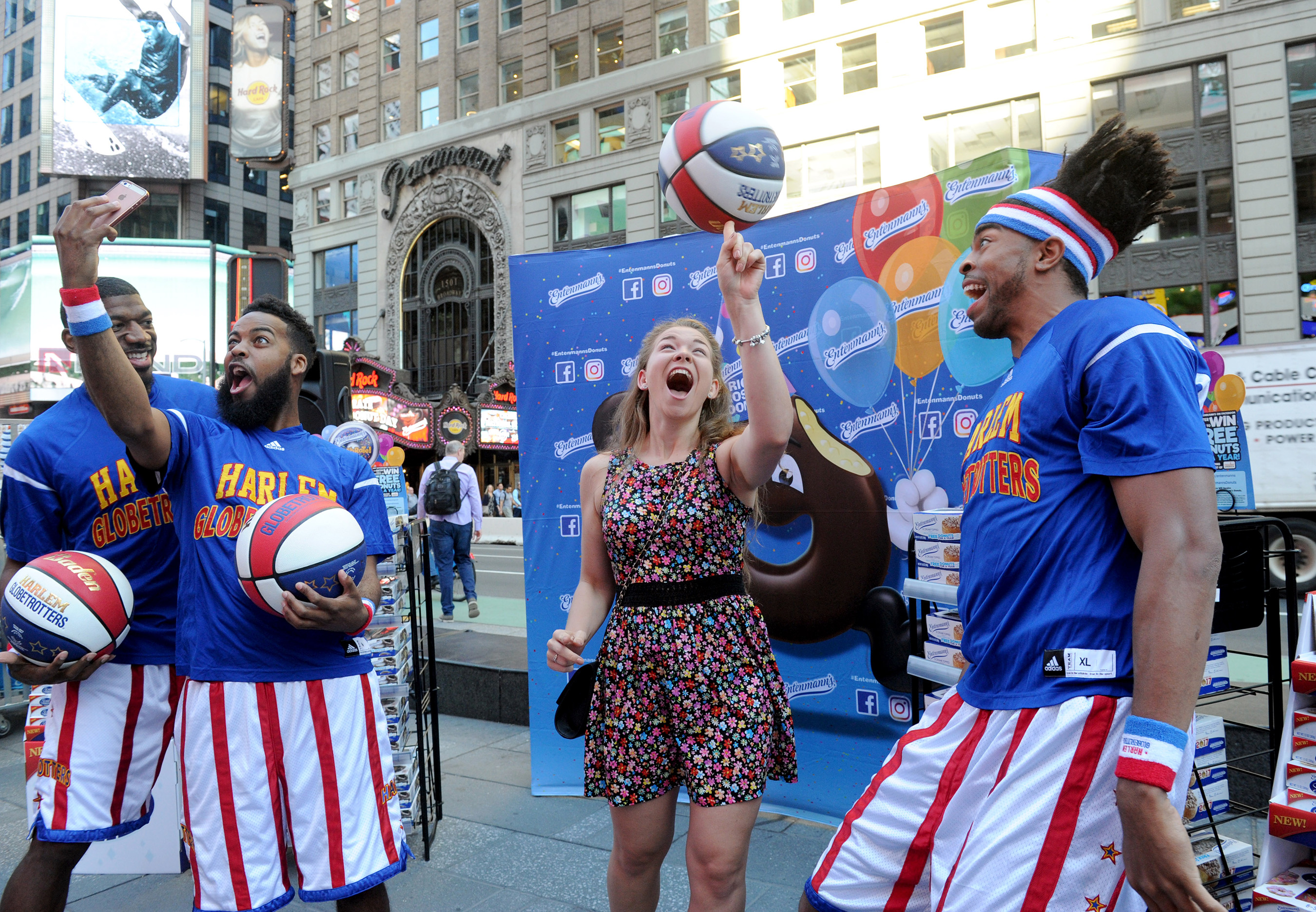 A fan celebrates National Donut Day with Entenmann's and the world famous Harlem Globetrotters in New York's Times Square, Friday, June 2, 2017.