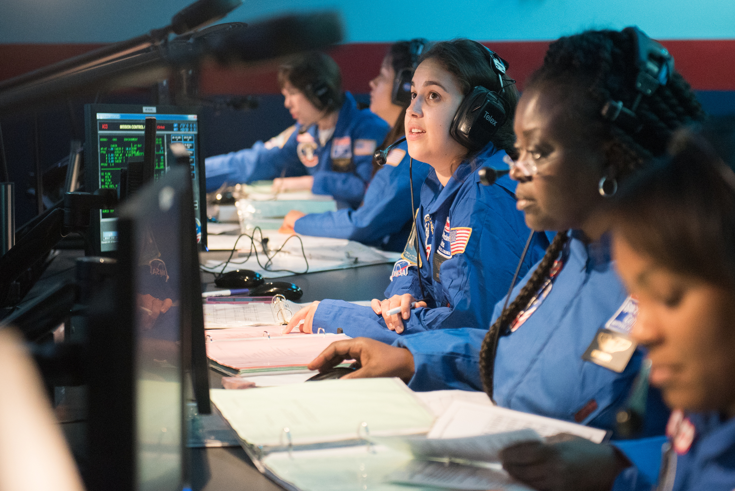Team Harmony conducting their Alpha space mission training. On the first day of camp, teachers are put into teams in which they conduct scenario-based space missions and other Space Camp activities.