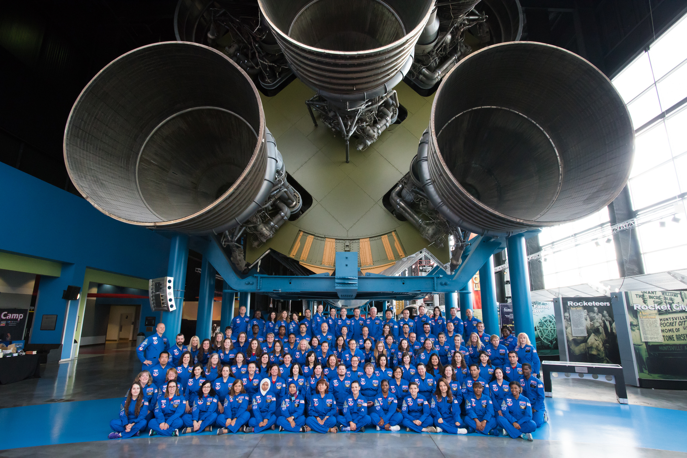 More than 200 educators who were part of the Honeywell Educators at Space Academy program in 2016 pose in front of the Saturn V rocket at the U.S. Space and Rocket Center in Huntsville, Ala.