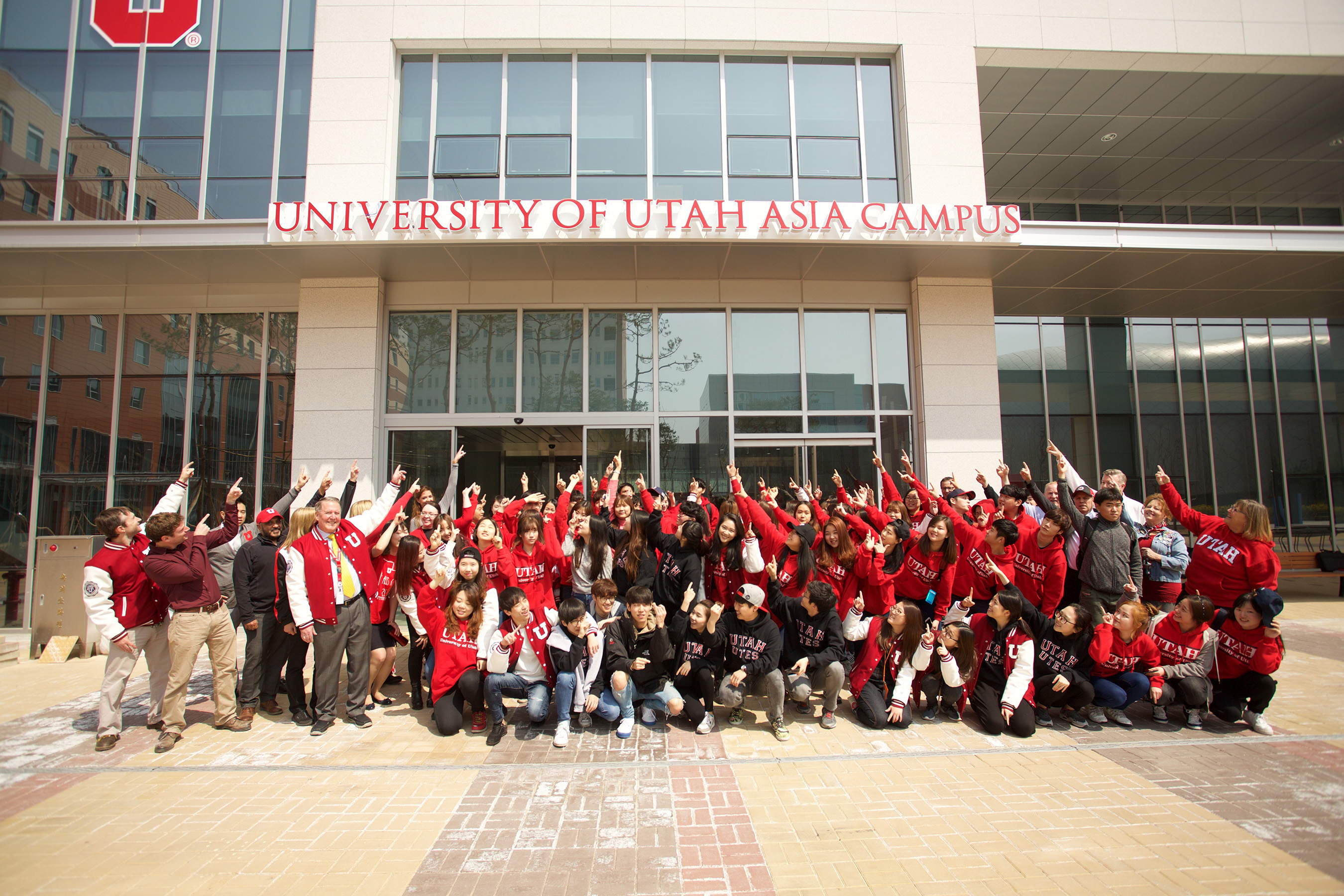 The University of Utah Asia Campus students pose at their academic building