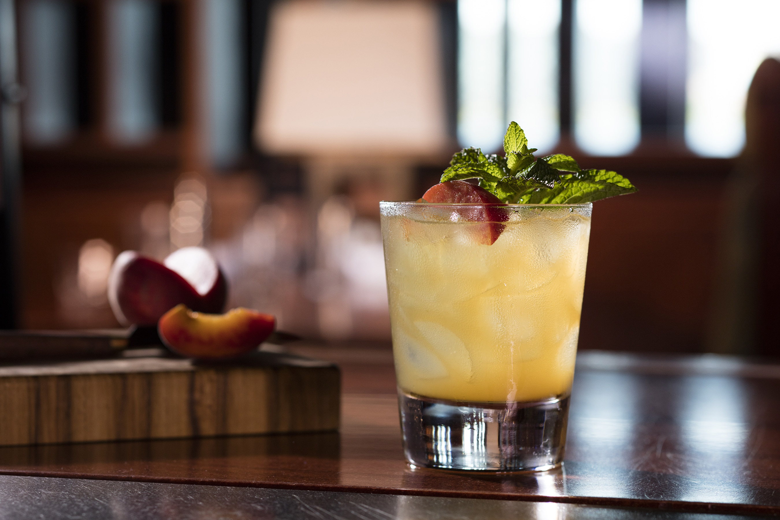 Bourbon Peach Smash: Flavors of sun-drenched peaches and cool mint compliment the trademark sweetness of Maker's Mark Bourbon in this refreshing handcrafted summer cocktail.