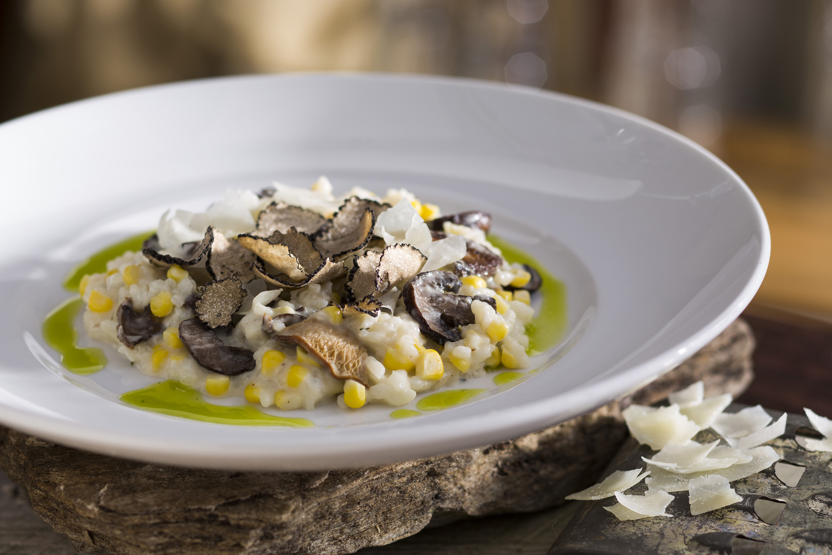 Summer Truffle Risotto: This highly anticipated dish hits the menu late July, featuring flavor-rich Black Truffles, roasted mushrooms & sweet summer corn. Harvested in Italy, the truffles are flown in & hand shaved to order.